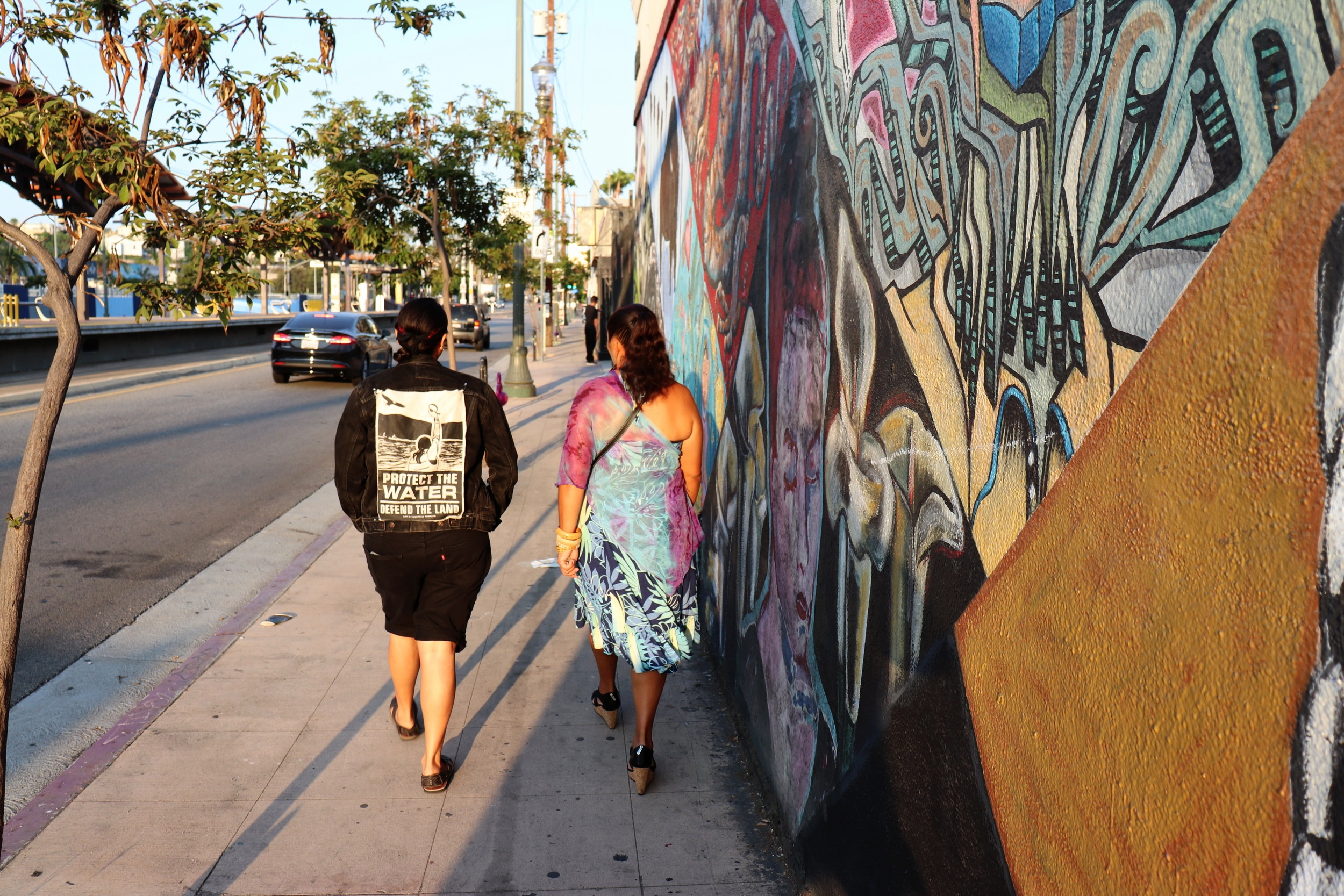 Indigenous locals walk together to the Run4Salmon Concert Tour.