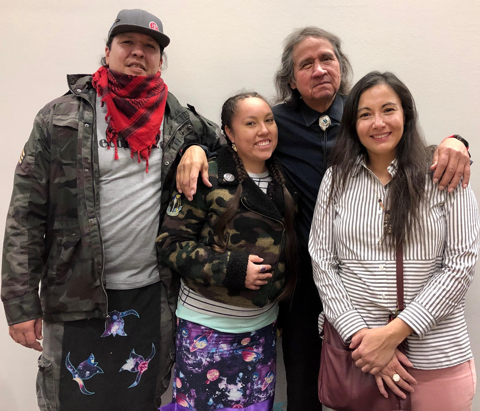 Manape LaMere (Sioux Nation of Indians), Sunrose Ironshell (Sicangu & Oglala Lakota), Frank LaMere (Winnebago) and Christine Nobiss (Plains Cree/Saulteaux) gather for a photo during the feast after the March to Honor Lost Children. Frank LaMere, a long time activist and community leader, is one of the co-founders of the march.