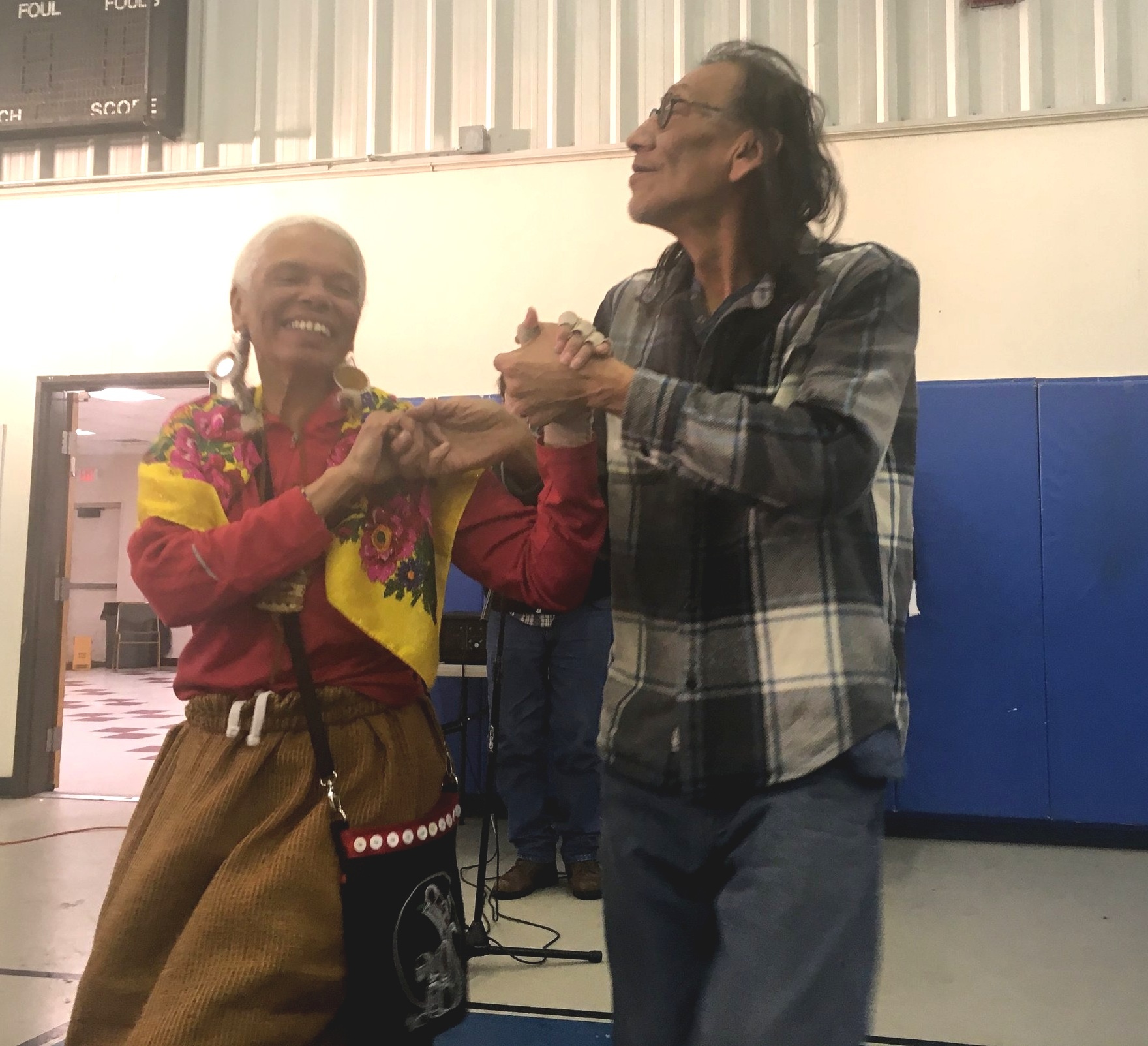 Nathan Phillips dancing with Carolyn Christmas, Mi'kmaq, during a break from the Standing Rock prayer walk in February 2018. By Rebecca Bengal