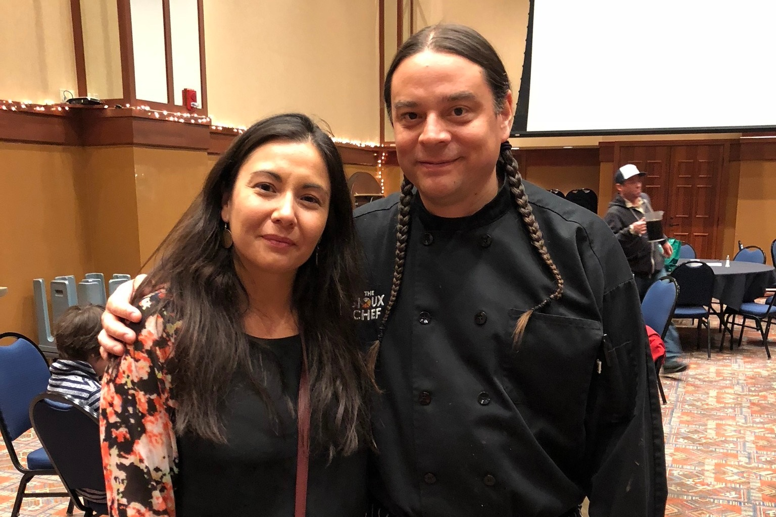Christine with the Sioux Chef, Sean Sherman, at the Great Lakes Intertribal Food Summit at the Meskwaki Nation in May 2018.