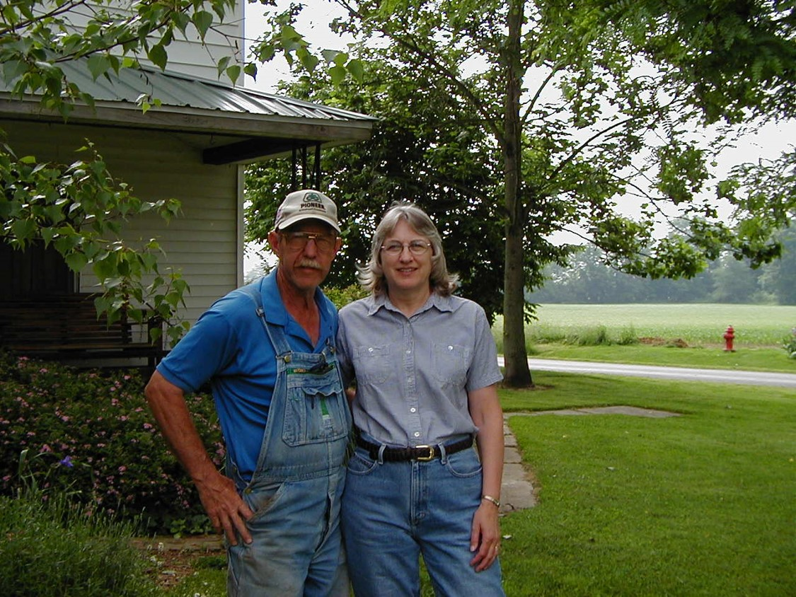 Mom and Dad with house.jpg