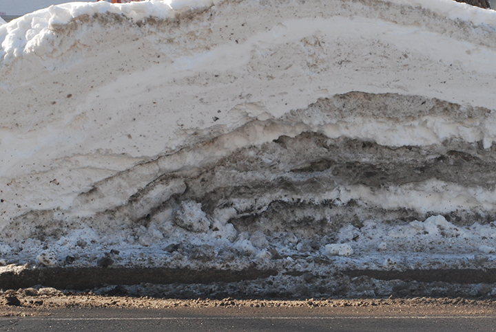 Overlap / Porous Boundaries:  An extension of both aggregates and gradient, the layers of snow and ice seen in this cross section along a residential road in Ottawa creates a layering of porous boundaries as ice from the layers above seep into lower strata compressing the pile into bands with blurred edge conditions. In this material condition the individual layers are visible, but their edges hard to definitively discern.
