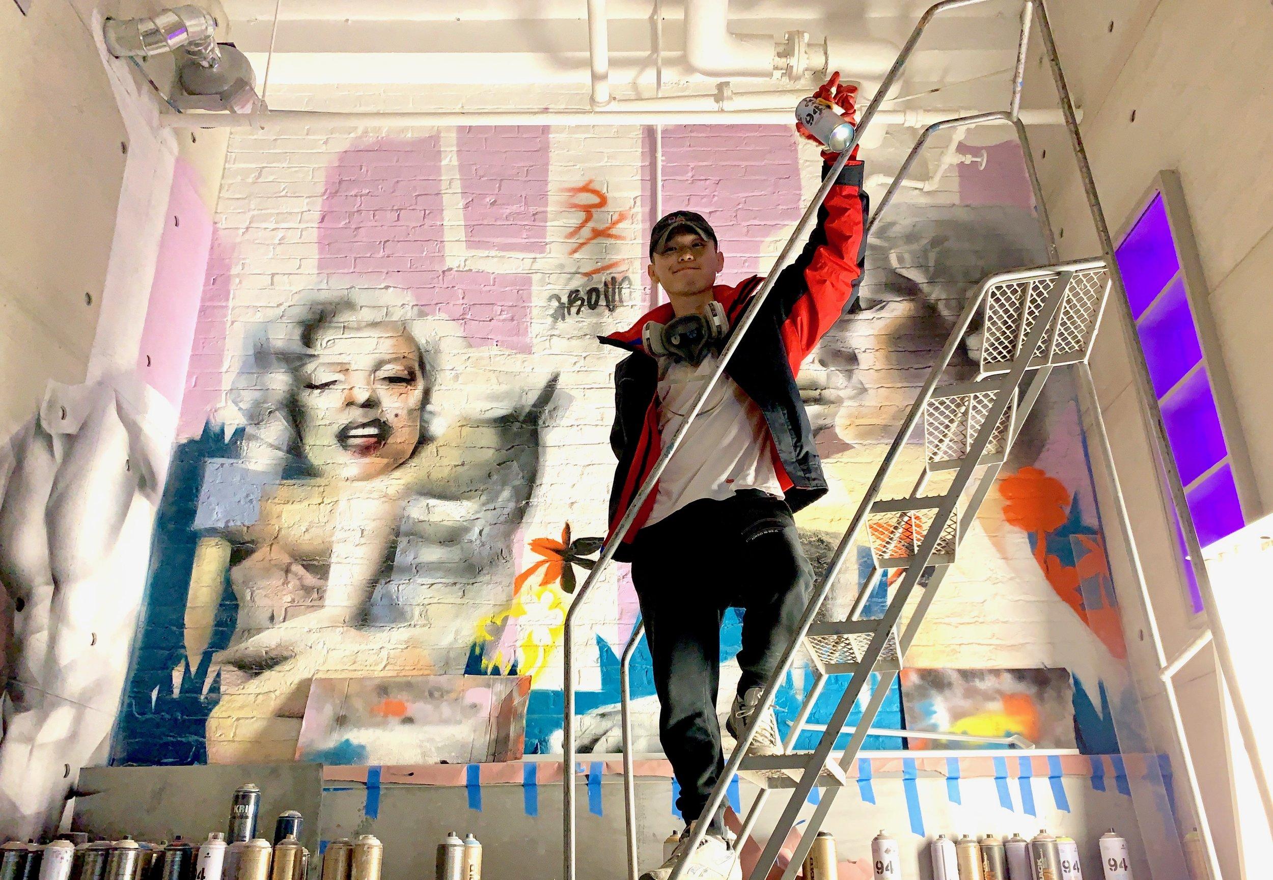 Kim working on mural