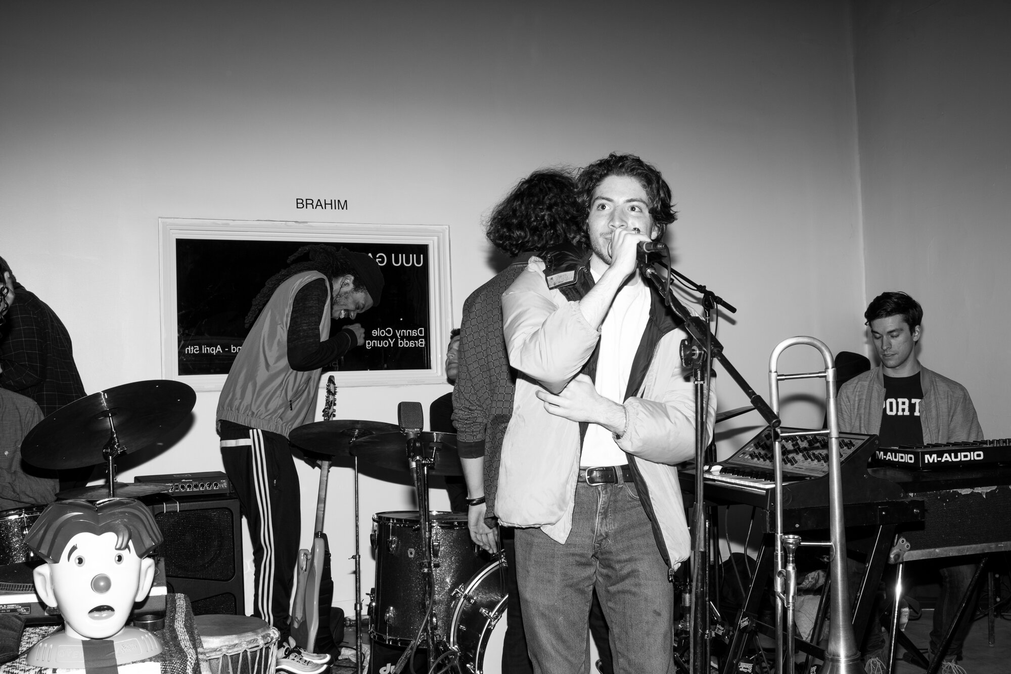 Cole speaking at his art opening at UUU GALLERY in March, 2019