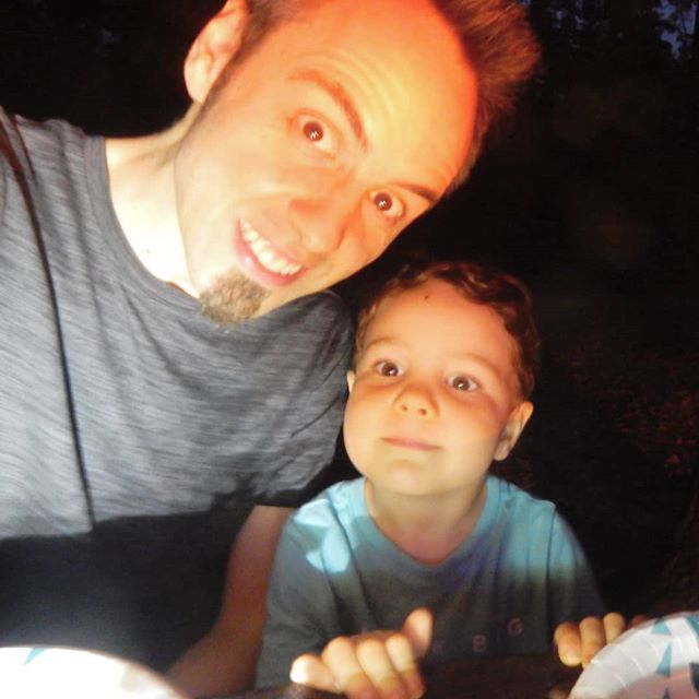 Just hanging out with my dad around the campfire waiting for dinner! did you watch our new video to see our camping fun? Link in bio! @thetravelvlogfamily #travelvlog #family
