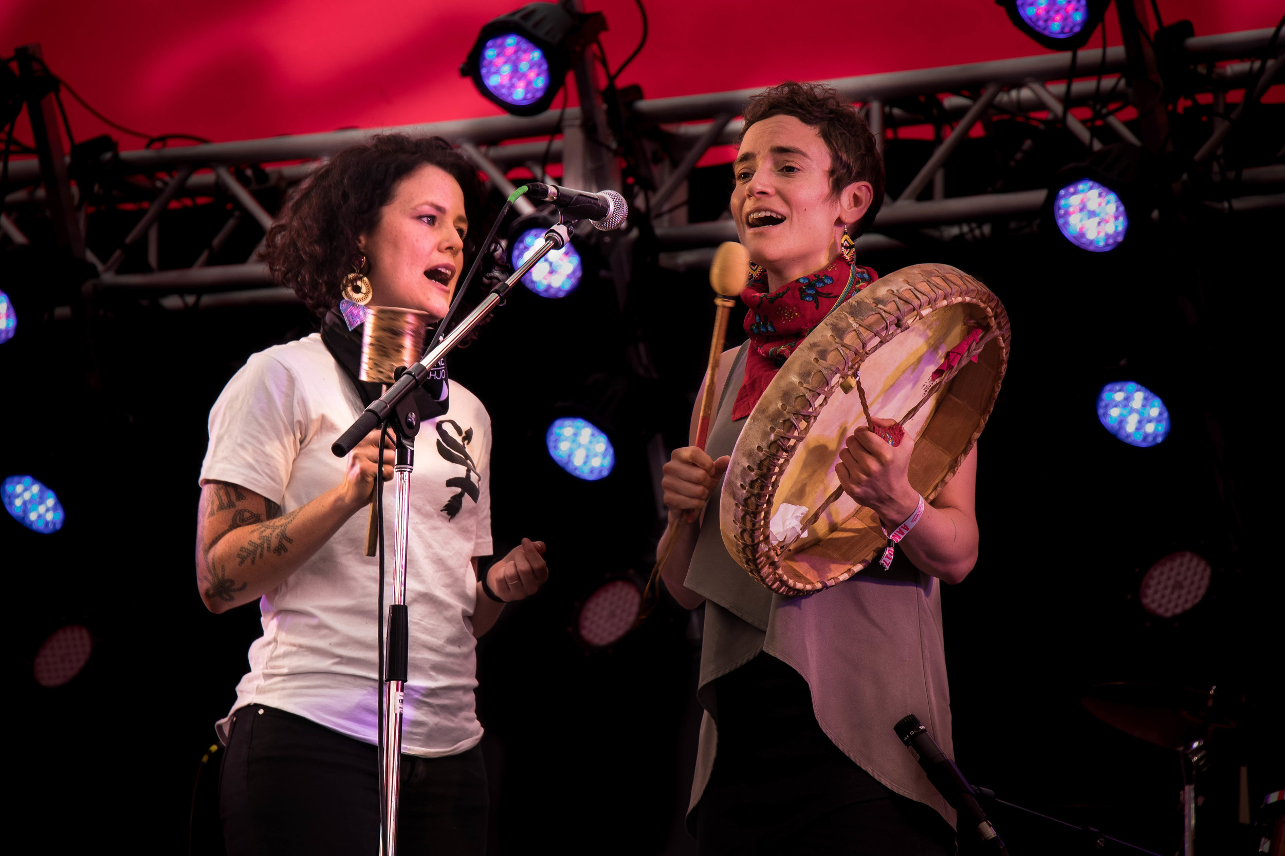 Musicians, Iskwé (left) and Moe Clark (right) sing their version traditional Indigenous ballad, Strong Woman Song.