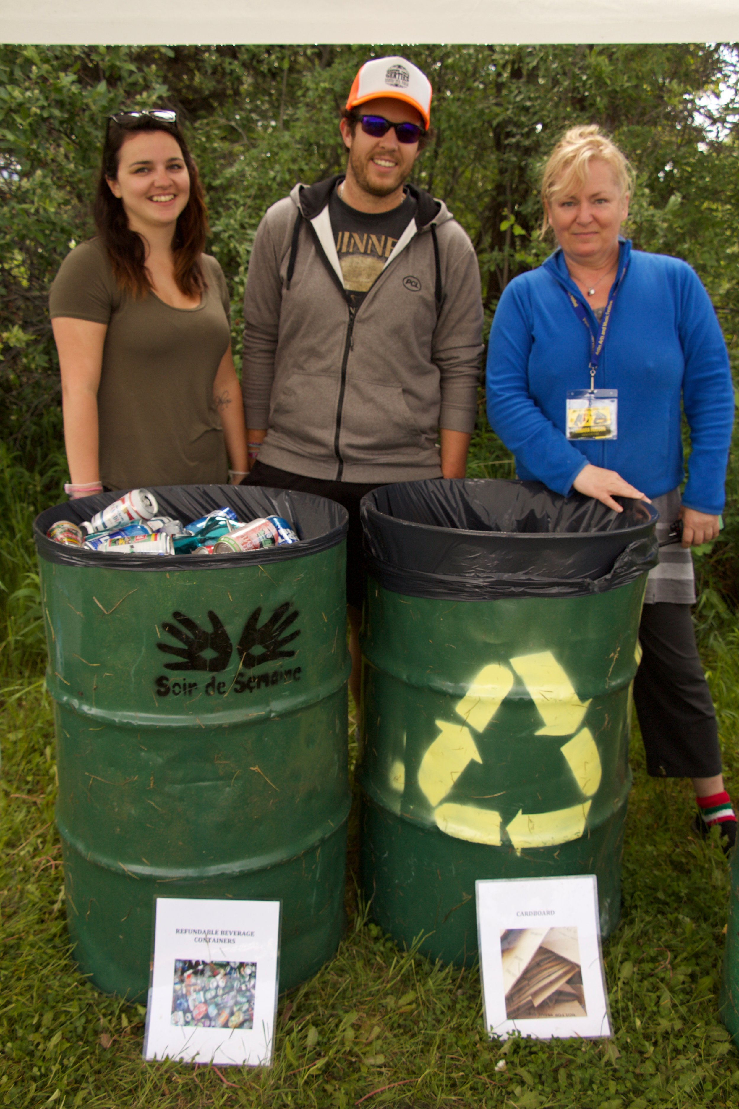 The green team at the Atlin Arts and Music Festival sorts through the recycling. Marissa Dumas and Matt Quinton are volunteers on the team (left and centre), Tamara Hudson (right) is the green team leader.