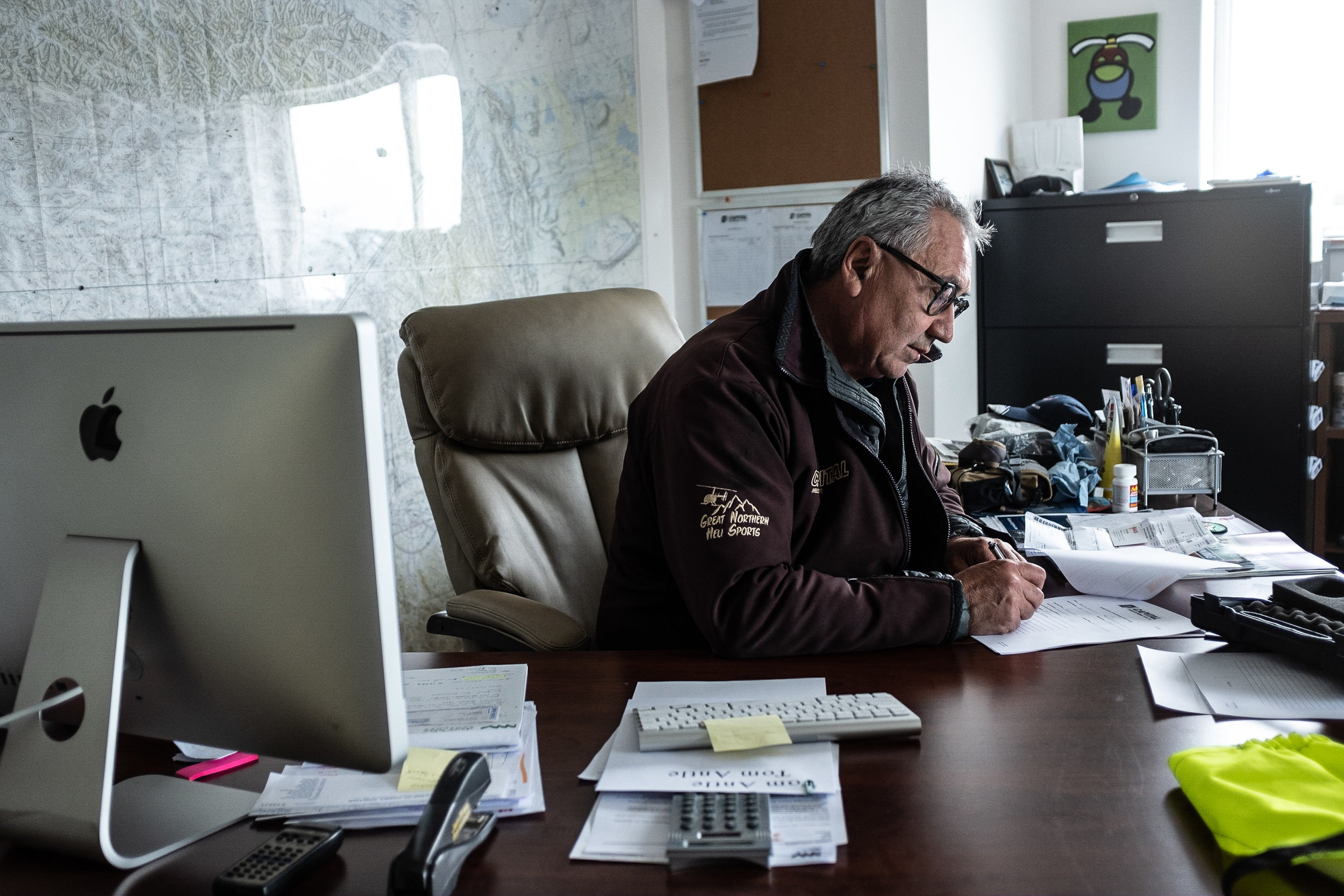 Delmar Washington, 60, spends around an hour each morning preparing paperwork and arranging flight schedules before departing on his first flight.