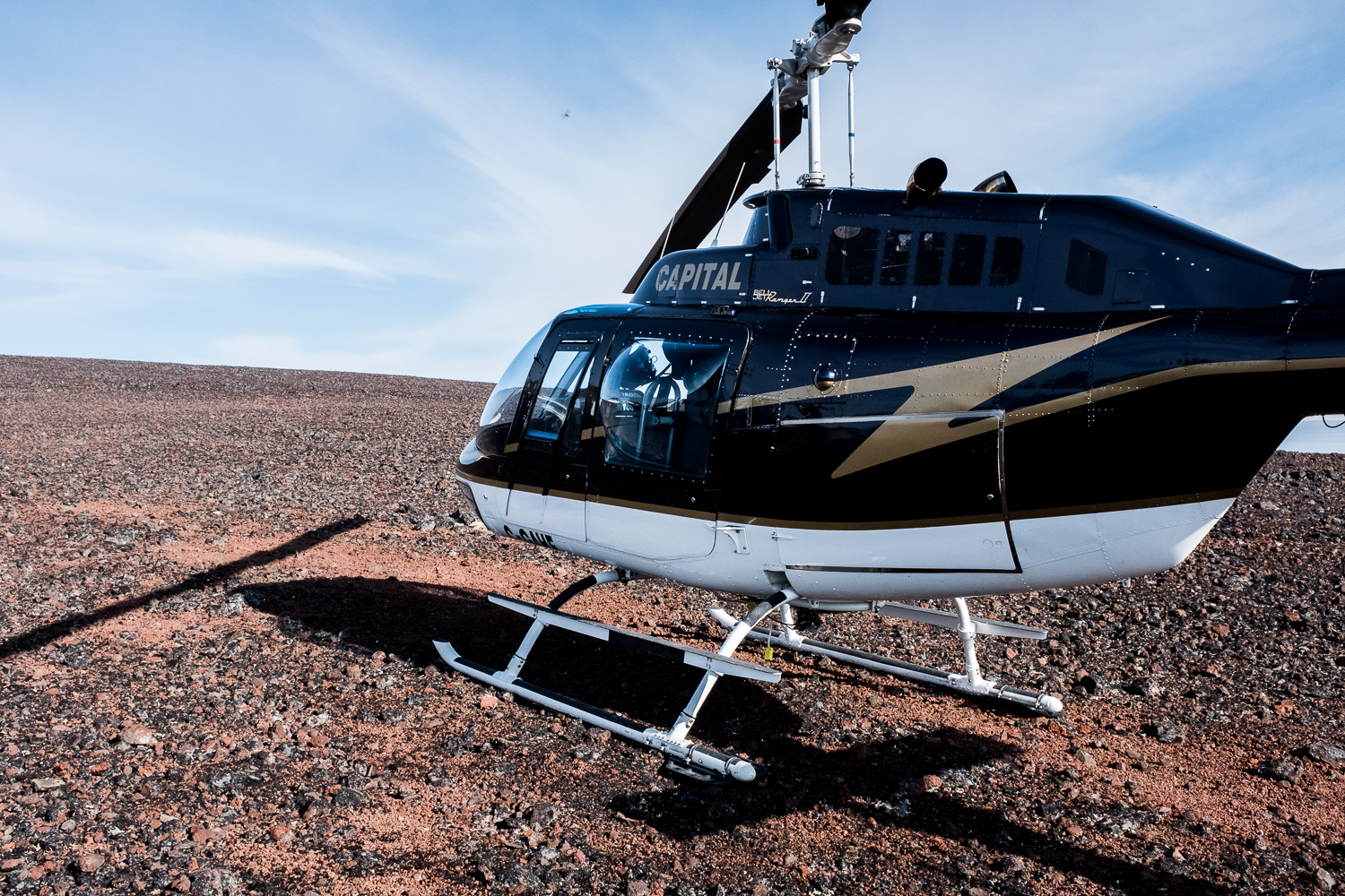 The Bell 206B Jet Ranger is a turbine engine helicopter capable of carrying four passengers.