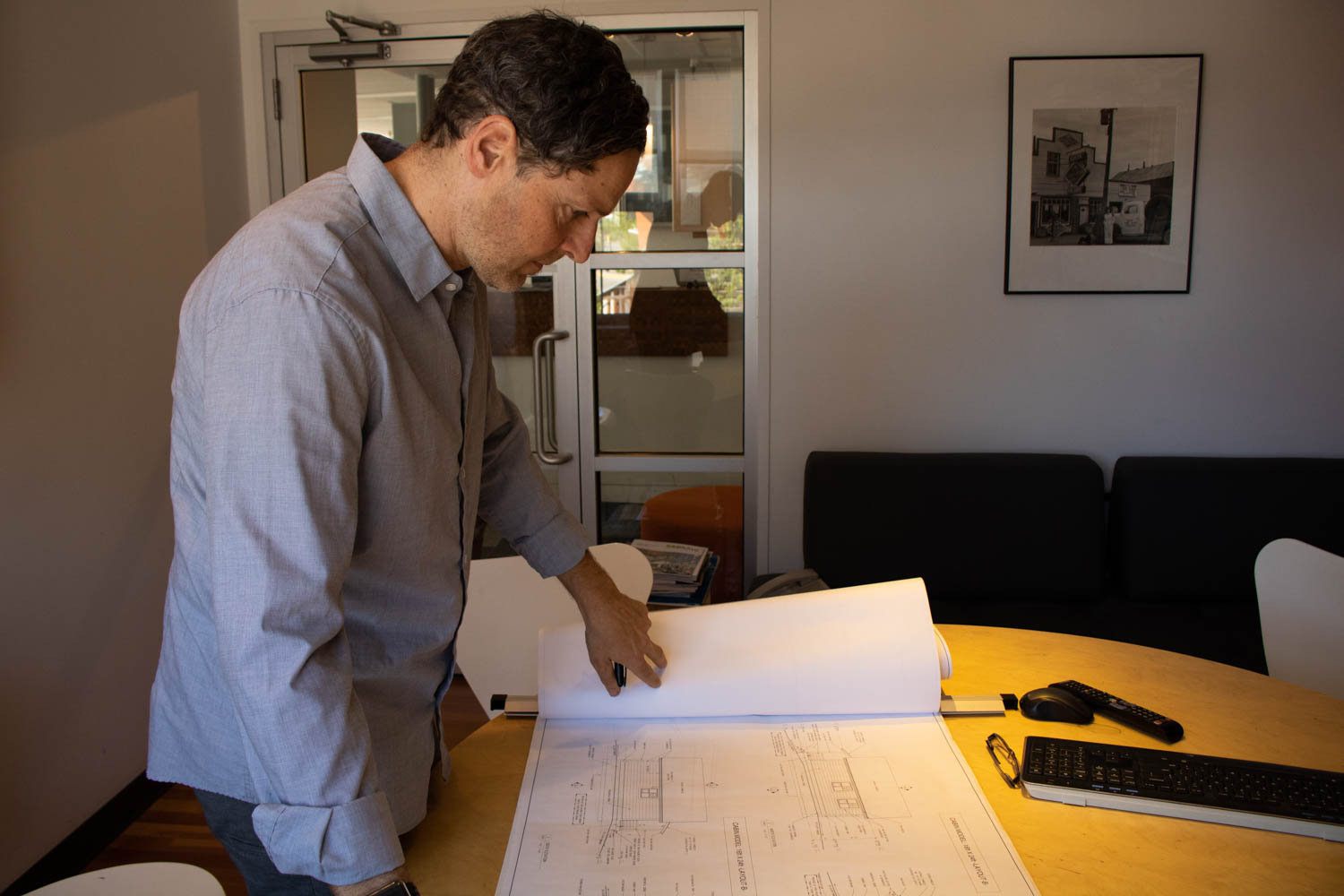 Antonio Zedda reviews the blueprints from the first phase of the Carcross/Tagish First Nation  initiative.