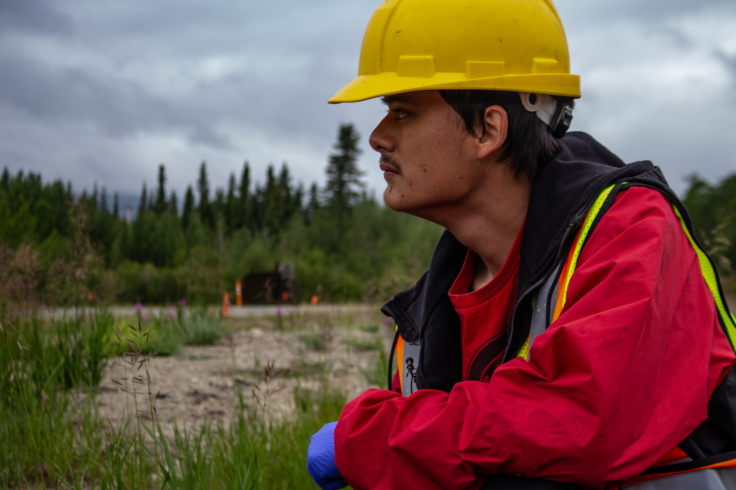 David Wally, 18, is one of 16 stewards working to clean up the land around Carcross. Photo by Madeline Lines.