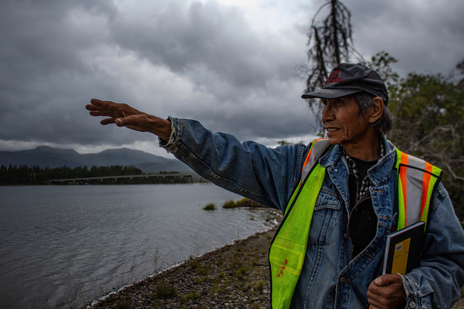 Johnny Johns, 64, oversees the work being done on the riverbanks he used to walk as a young man. He can't remember a time when the water cut into the banks as deeply as it does now. Photo by Madeline Lines.
