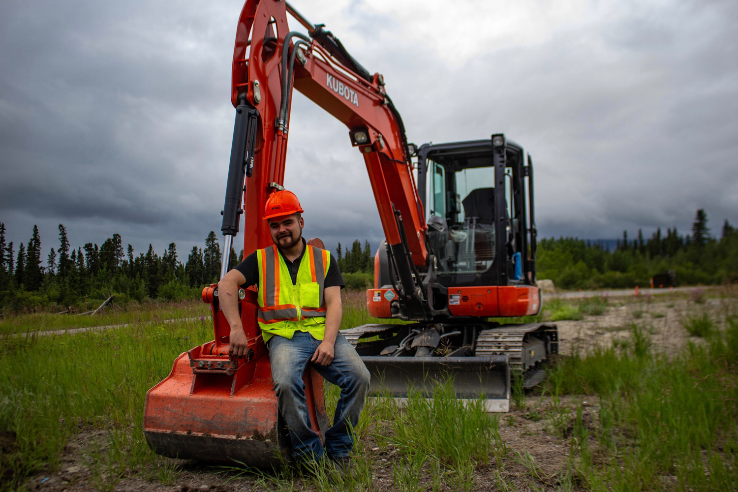 Kashies James excavates soil at the former Chooutla residential school site so it can be tested for toxic material. Photo by Madeline Lines.