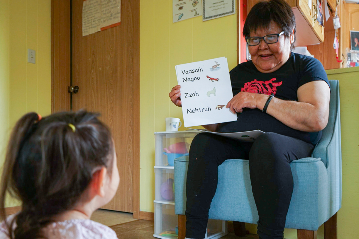 Elizabeth Kyikavichik, 74, shows flash-cards of animals and their Gwich'in names to the children at her daycare. (Photo: Clare Duncan)