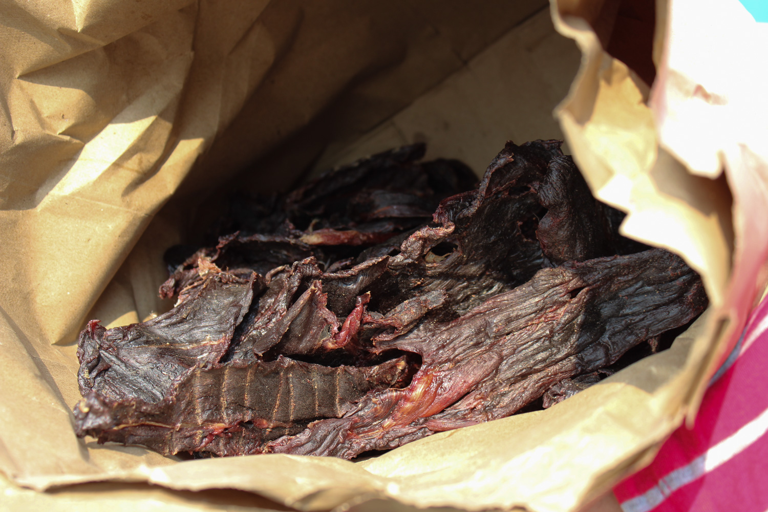 Caribou jerky after it has been dried in a smokehouse. (Photo: Sarah Sibley)