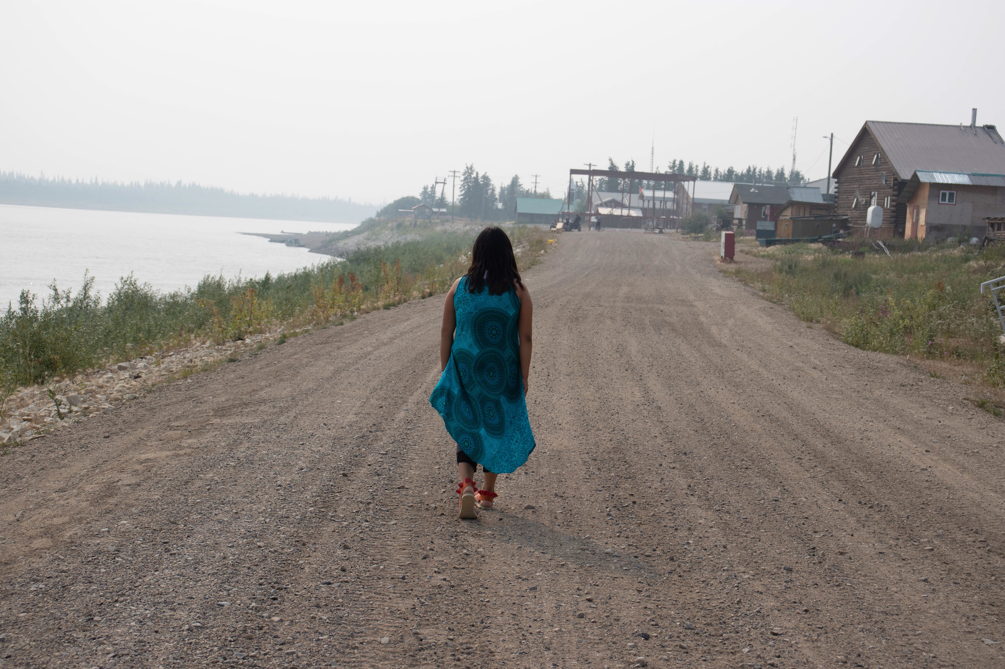 Crystal Charlie, flanked by the community of Old Crow and the Porcupine River. (Photo: KC Hoard)