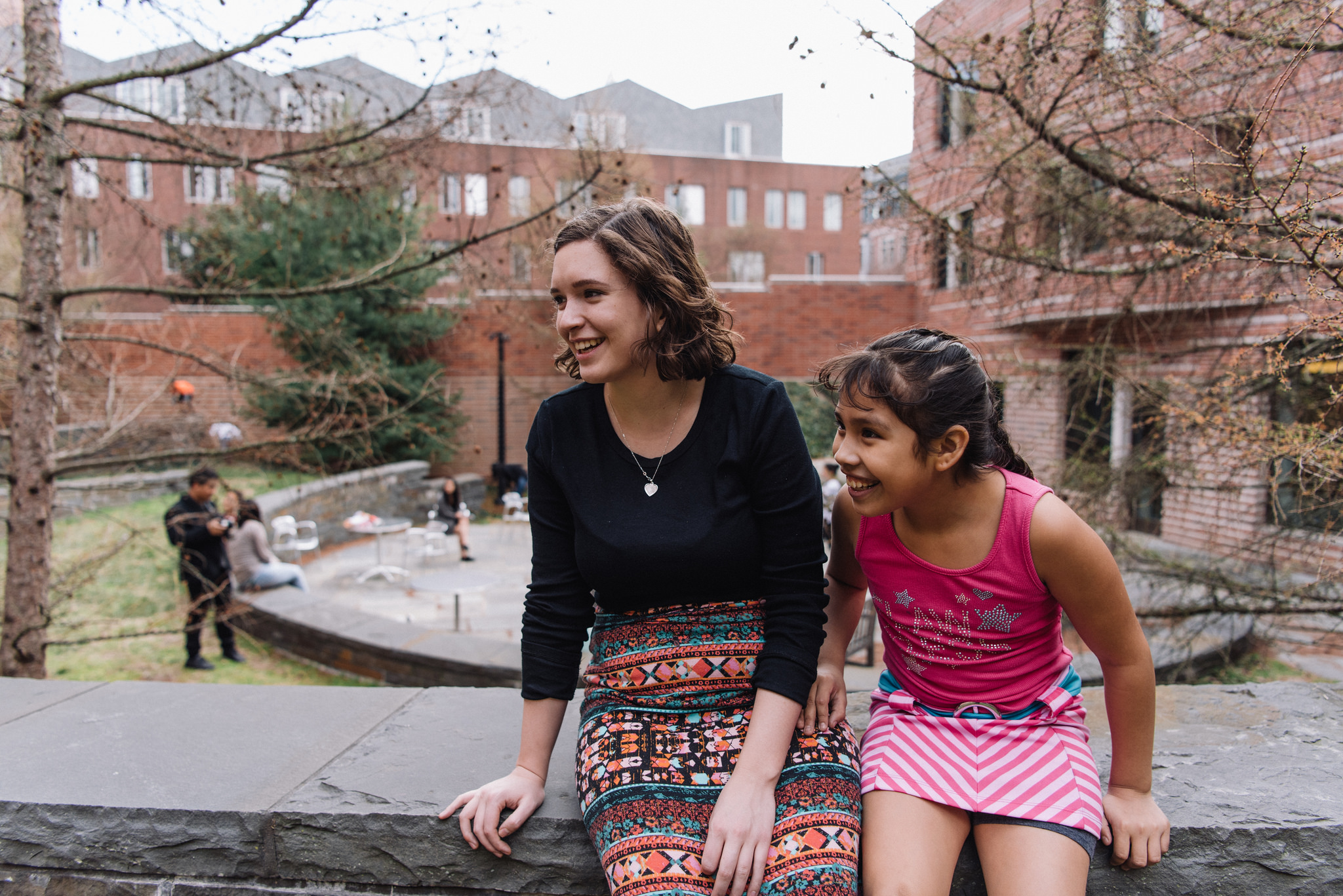 Princeton student and young mentee having a conversation on the Princeton campus.