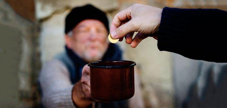 homeless-giving-charity-donation-giving-positive-735-350.jpg