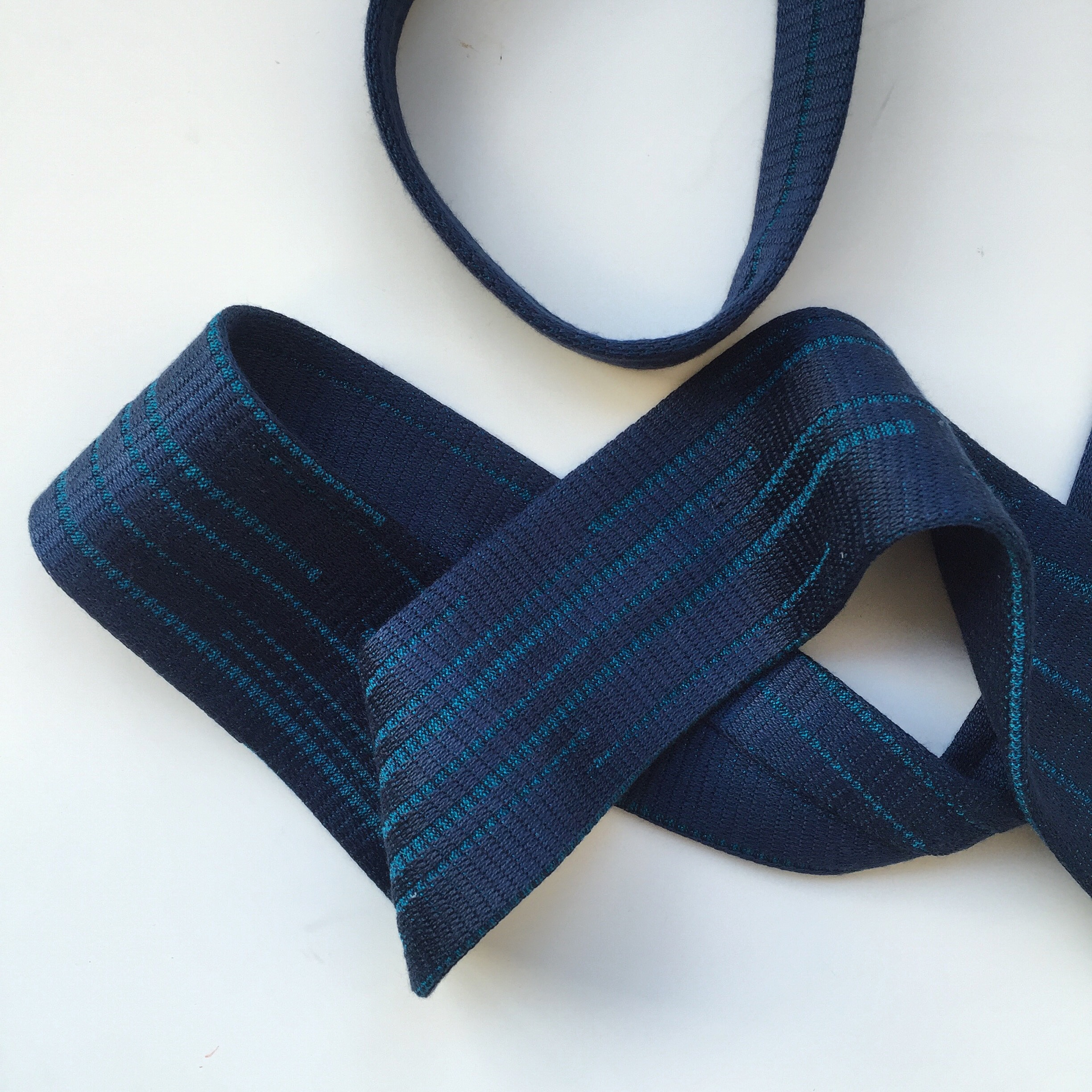 Customised silk knitted tie in blue.
