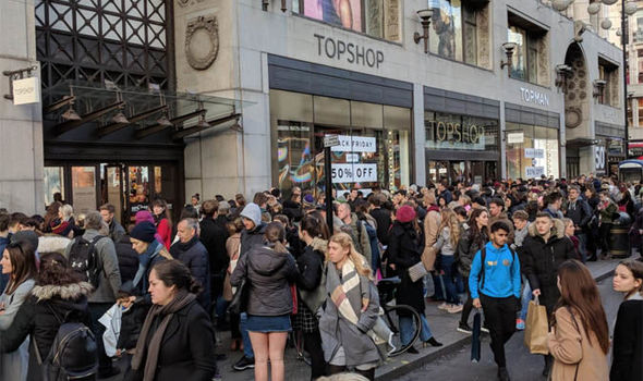 busy oxford street shoppers
