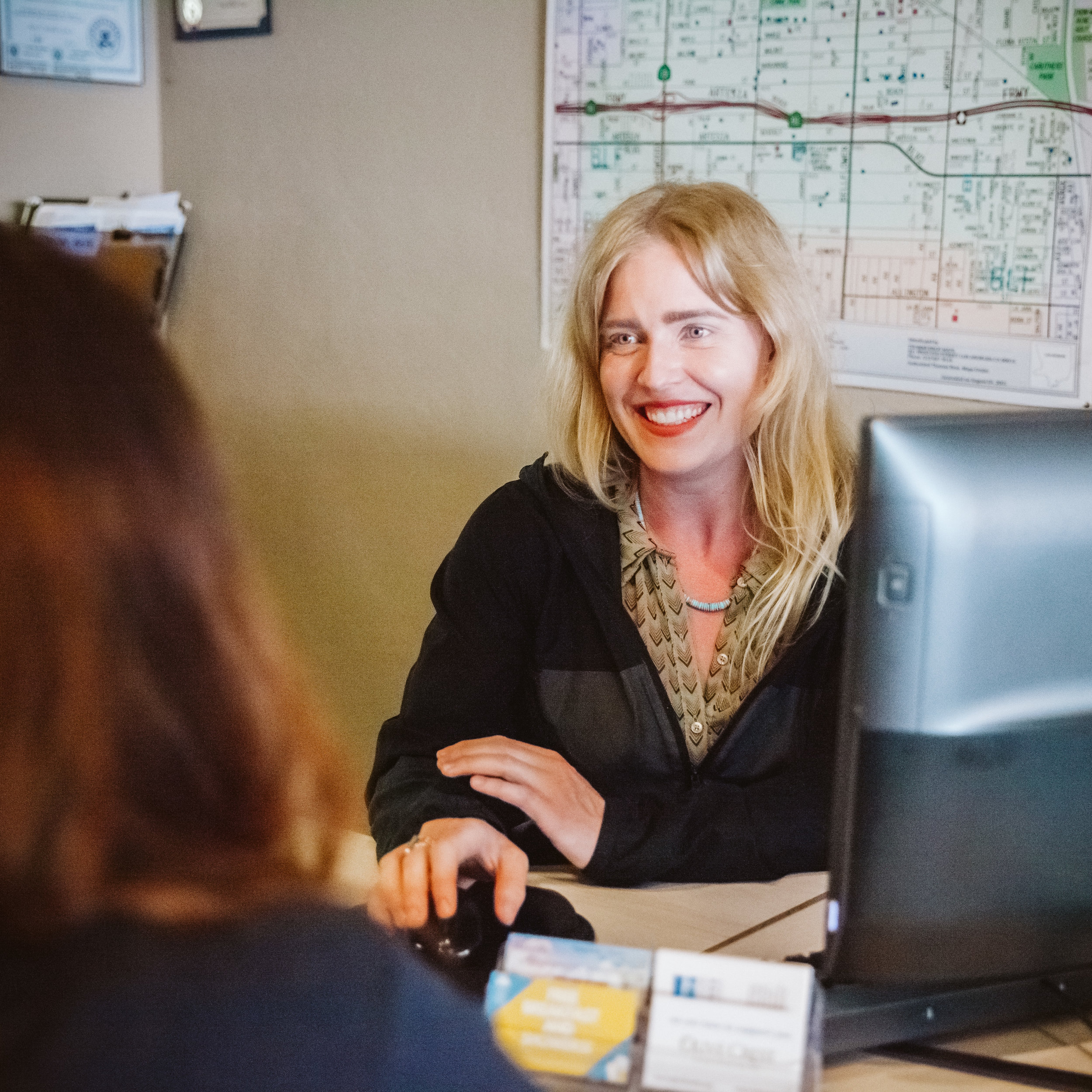 RECEPTIONIST - Are you a friendly face that loves interacting with our neighbors? Then we would love to have you help at our front desk!