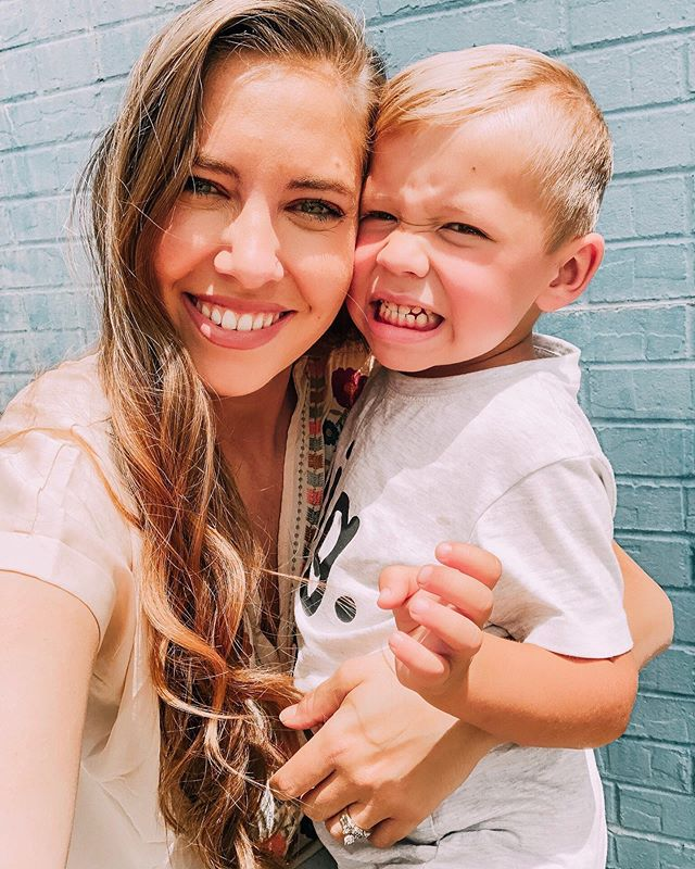 """This is Asher's """"I love you so much I'm gonna pinch you"""" face 🙄💕💕 Today I attended the sweetest Mother's Day Tea at bug's school, swipe to see the cuteness! 💐🍵"""