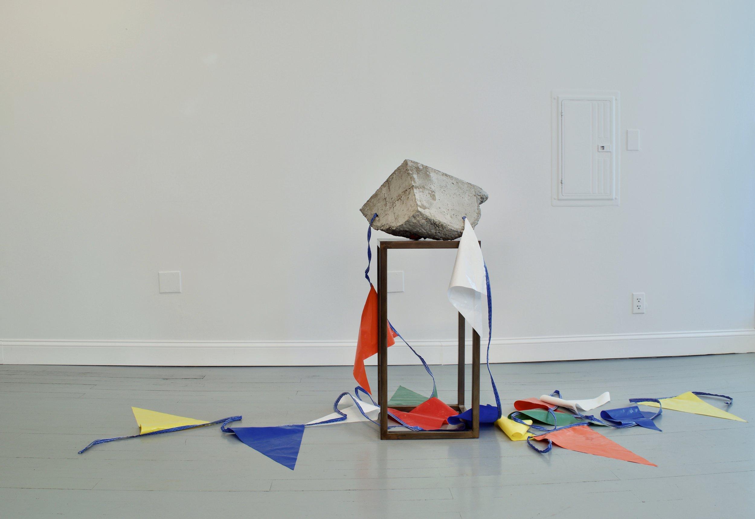 "Jeff Feld, ""Sale of The Century"", 2015. Concrete, steel, nylon pennant. 40 x 19 x 20 in."