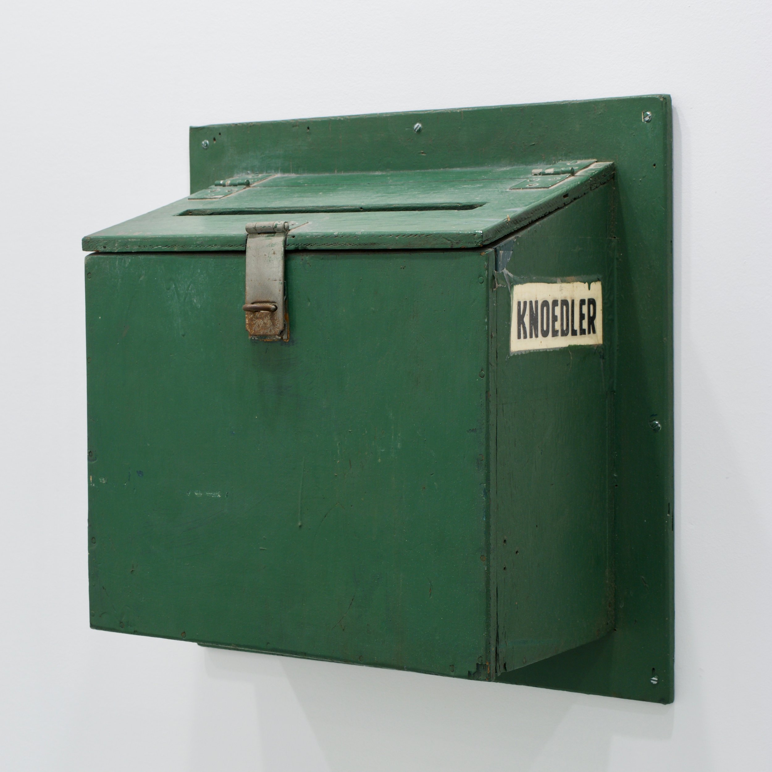 "Nick DePirro, ""Knoedler"", 2017. Painted wood, lock, paper. 20x20x9 in."