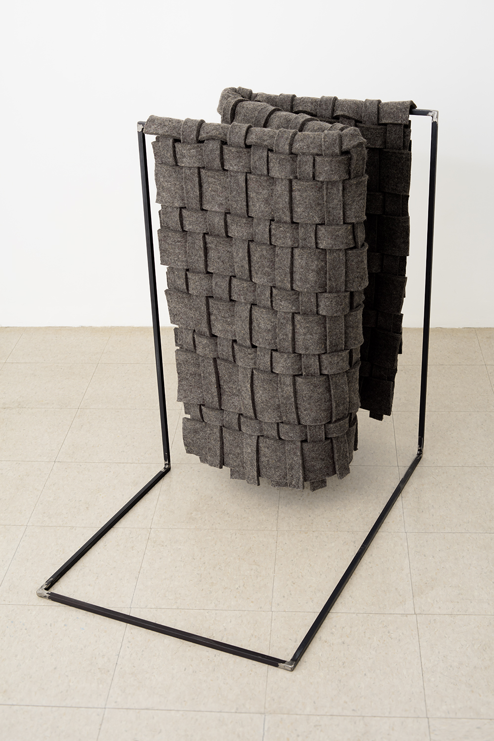 "Laura Kaufman, ""Standing Fold"", 2016. Felt, steel, glue. 37x37x21 in."