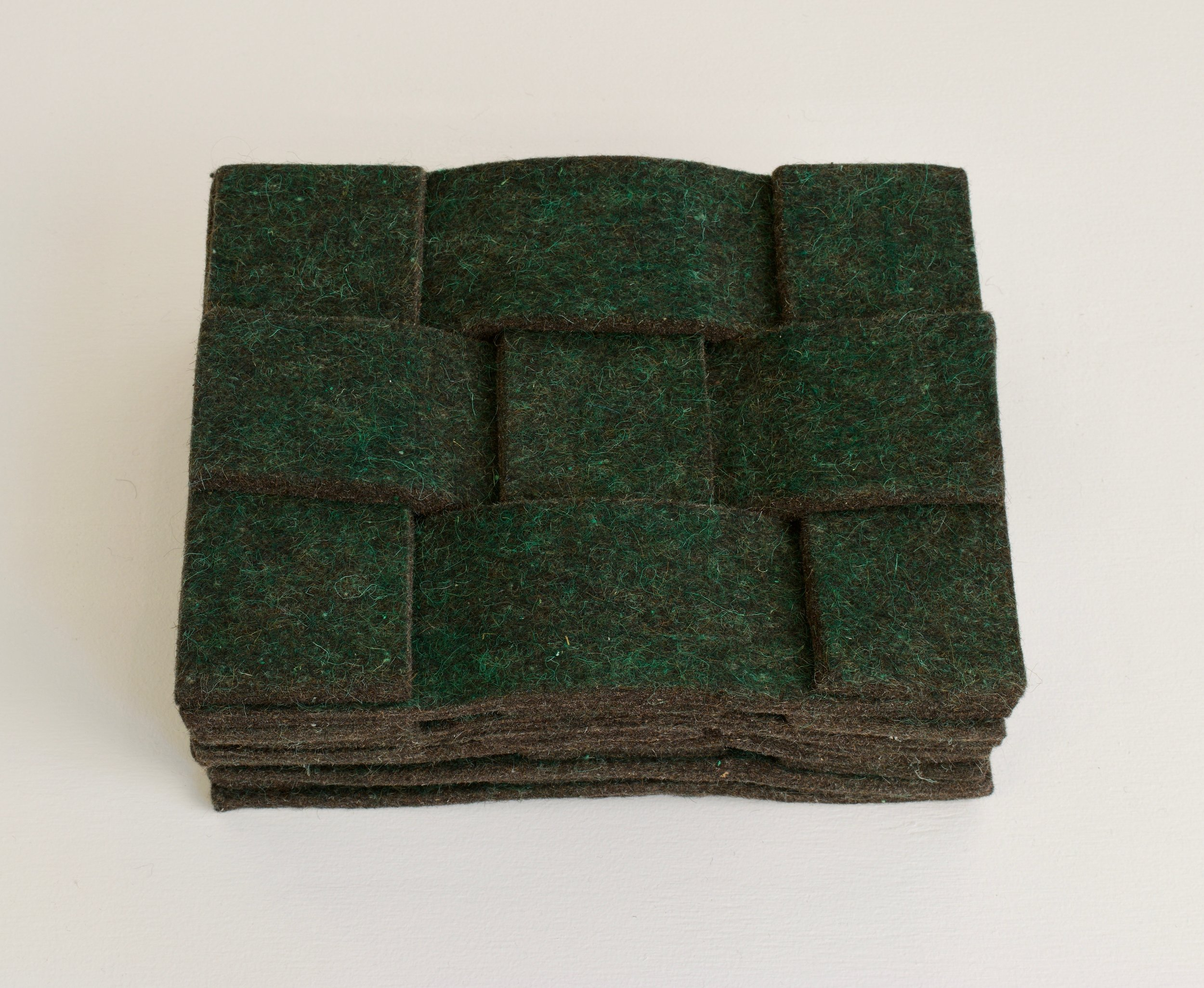 "Laura Kaufman, ""Divot"", 2015. Felt, wax, crayon, glue. 11x14.5x6 in."