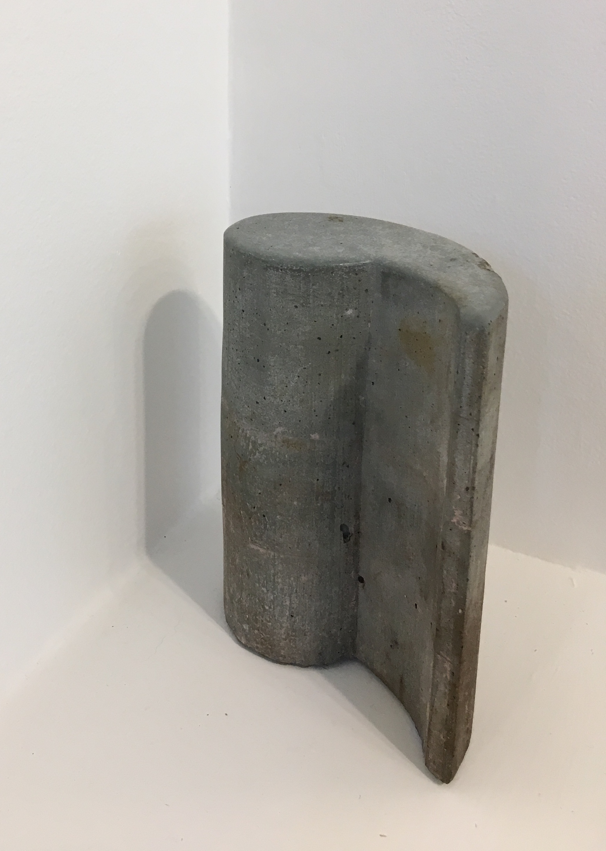 "Laura Kaufman, ""Rose Comma"", 2012/2018. Concrete, soil. 7x5.5x3 in."