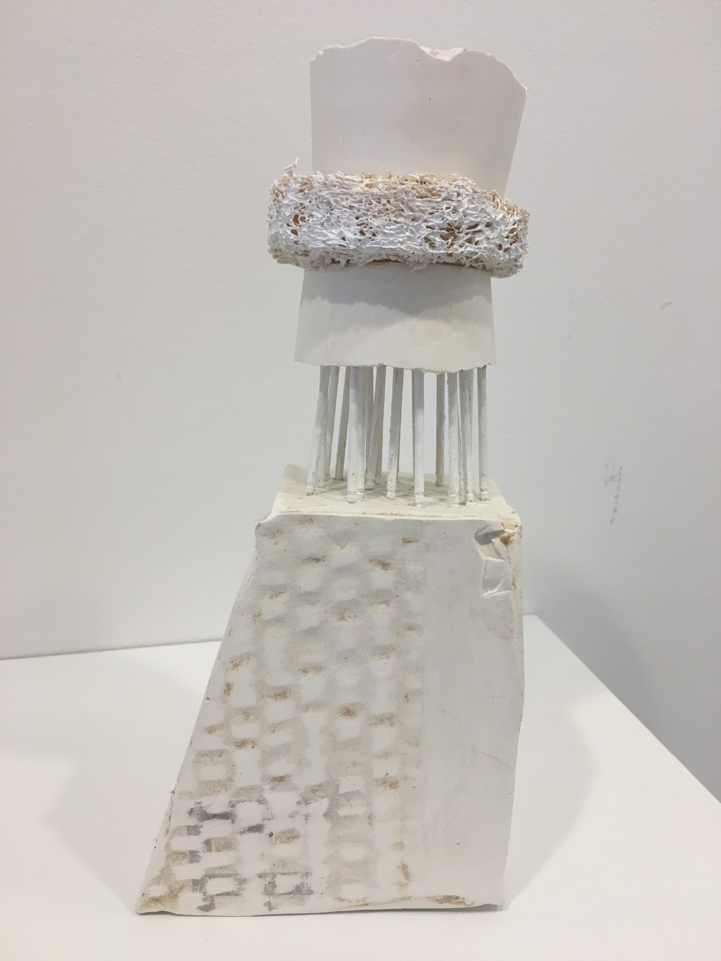 White Tower, 2016. Plaster, wooden sticks and loofah, 8x3 3/4x 2 3/4 in.