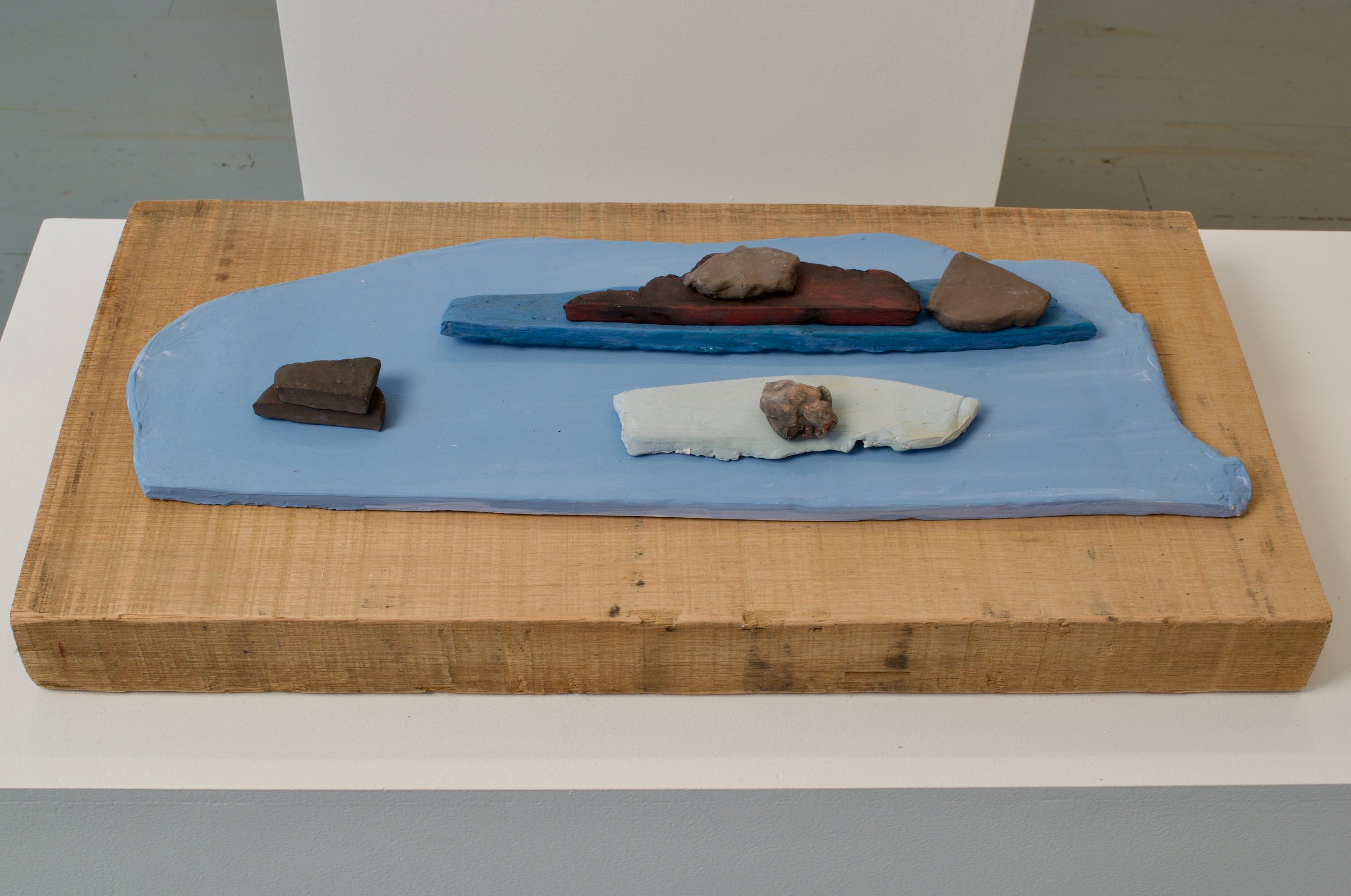 Katia Ramsey-Read, Waterscape, 2019. Bisqued Stoneware on Wood, 3 ¼ x 12 x 24 inches