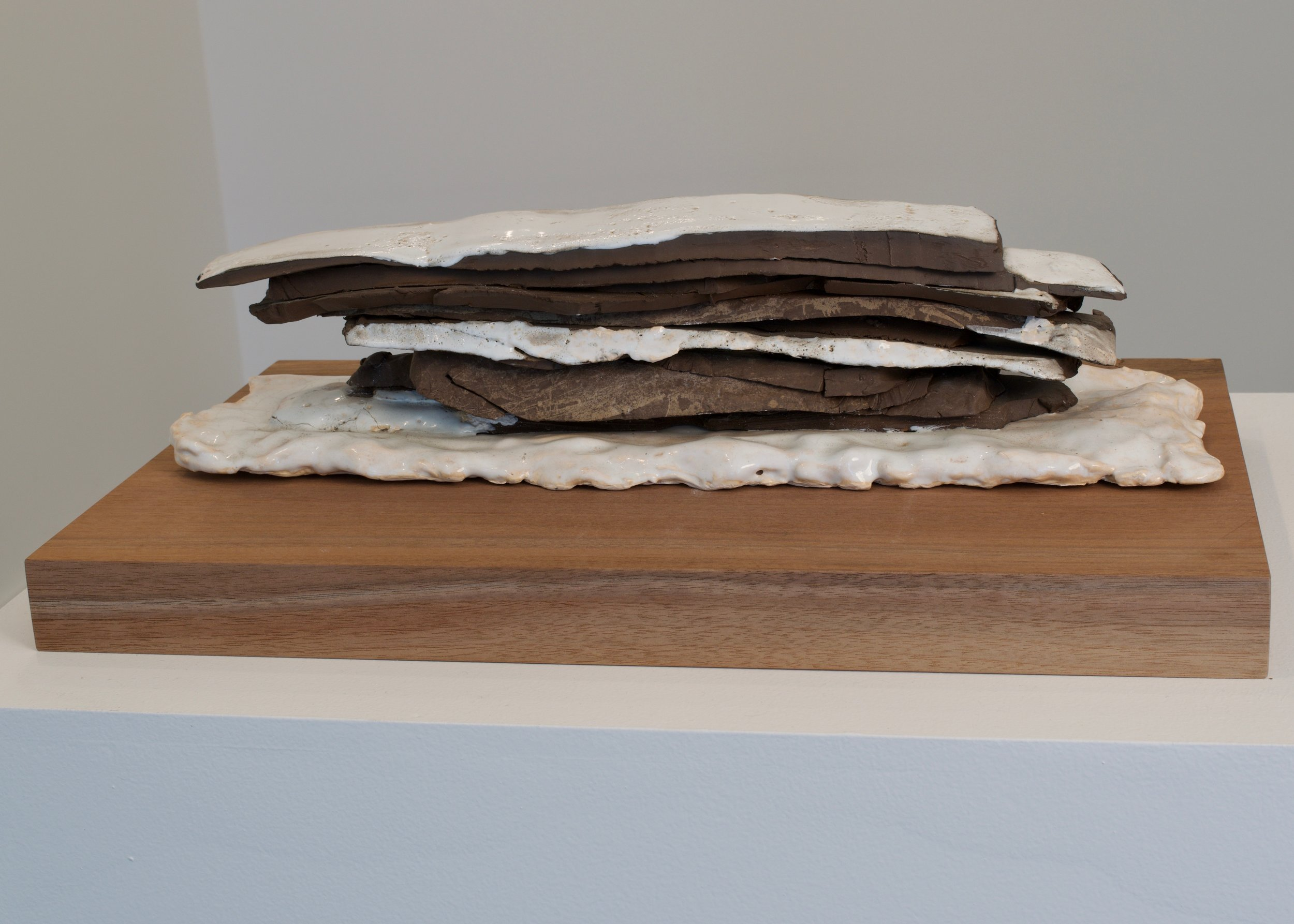 Katia Ramsey-Read, Wood Pile in Snow, 2019. Glaced Stoneware and Terra Cotta on Wood, 18 ½ x 5 ½ x 4 ½  inches