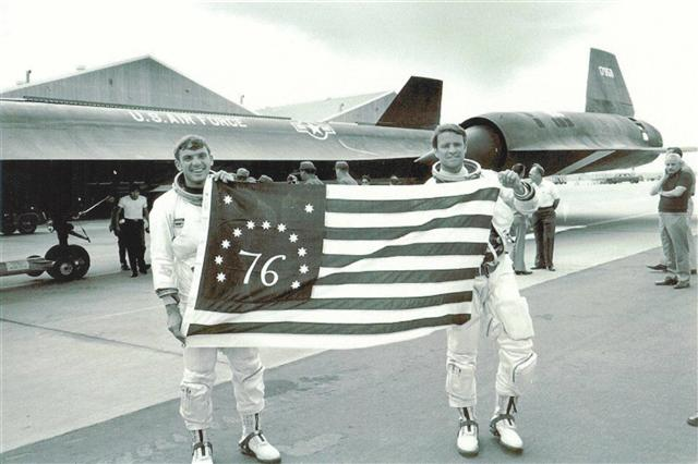 Col Morgan and Maj Gen Joersz holding this Bicentennial Flag that accompanied them after their historic flight. Beale AFB, 28 July 1976  Lockheed Video