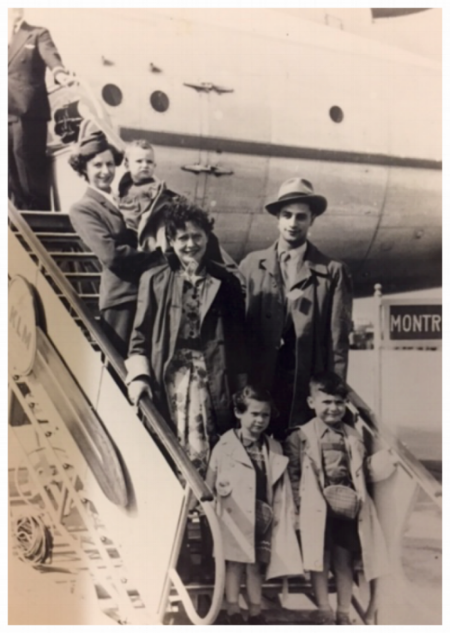 Miriam (in the flight attendantt's arms) arriving in Montreal with parents and siblings. August 1953