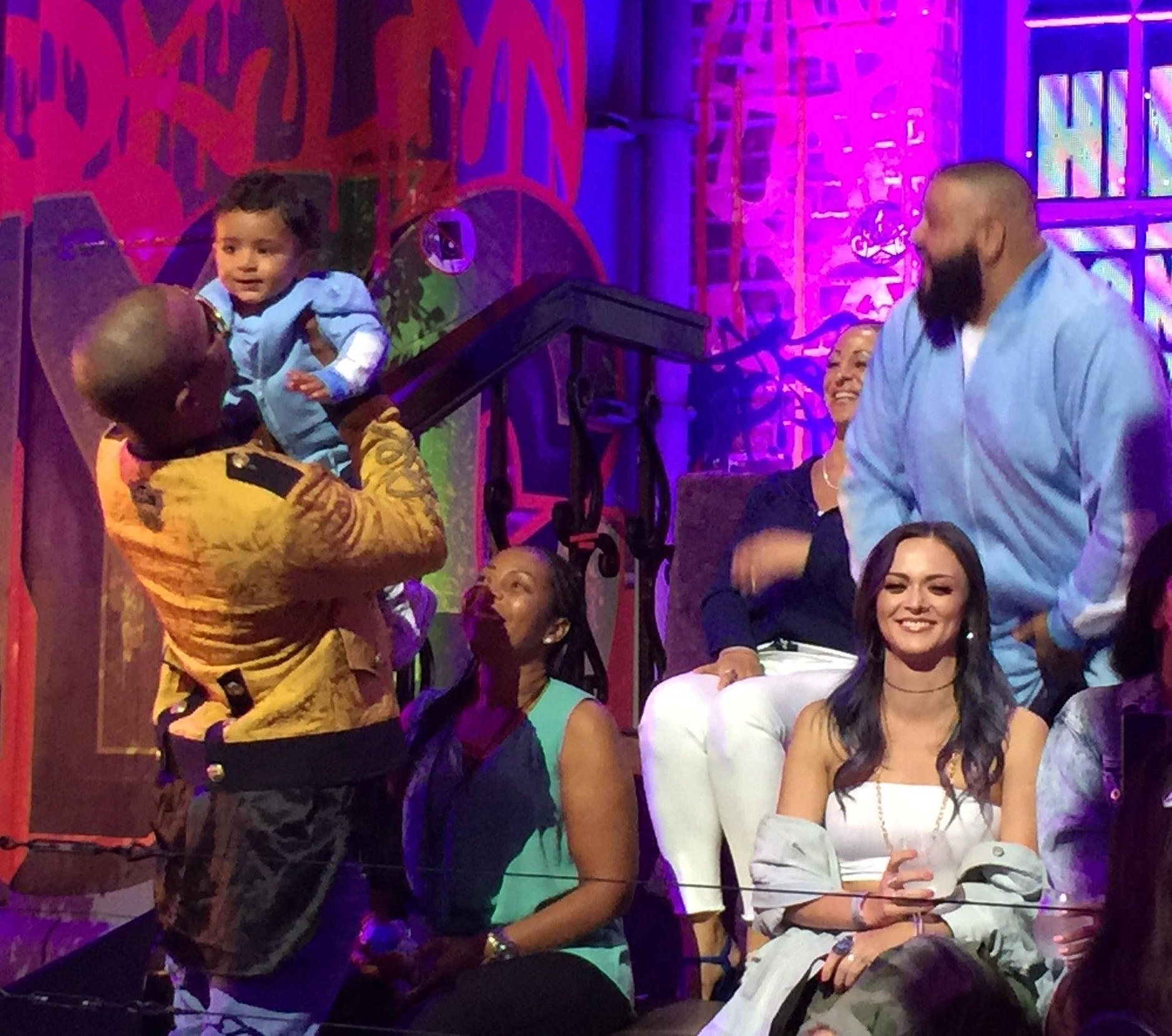 The cutest moment of the night was when T.I.walked to the audience bleachers and picked up DJ Khaled's son in his arms.
