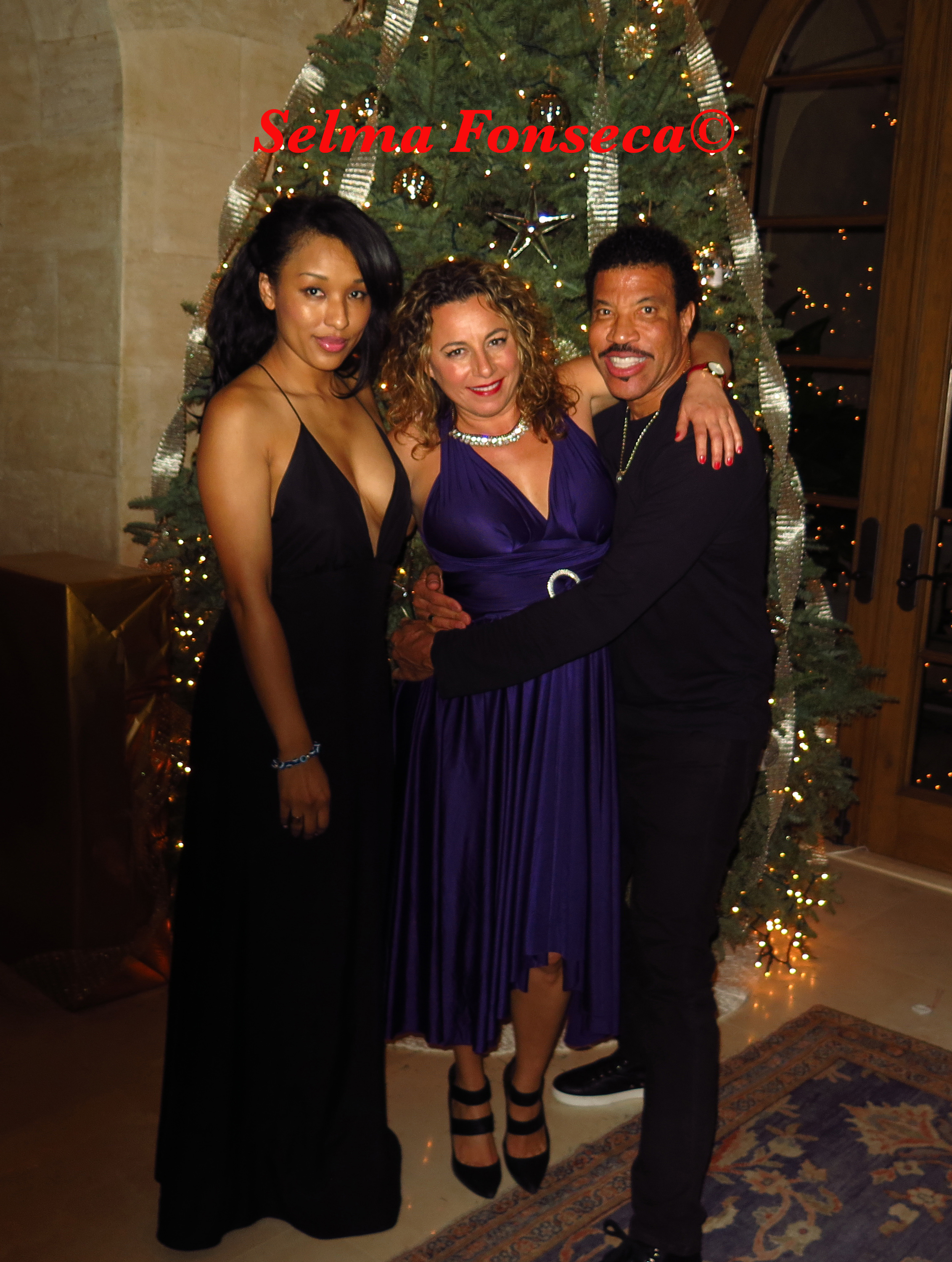 Lisa Parigi, Selma Fonseca and Lionel Richie celebrating Christmas