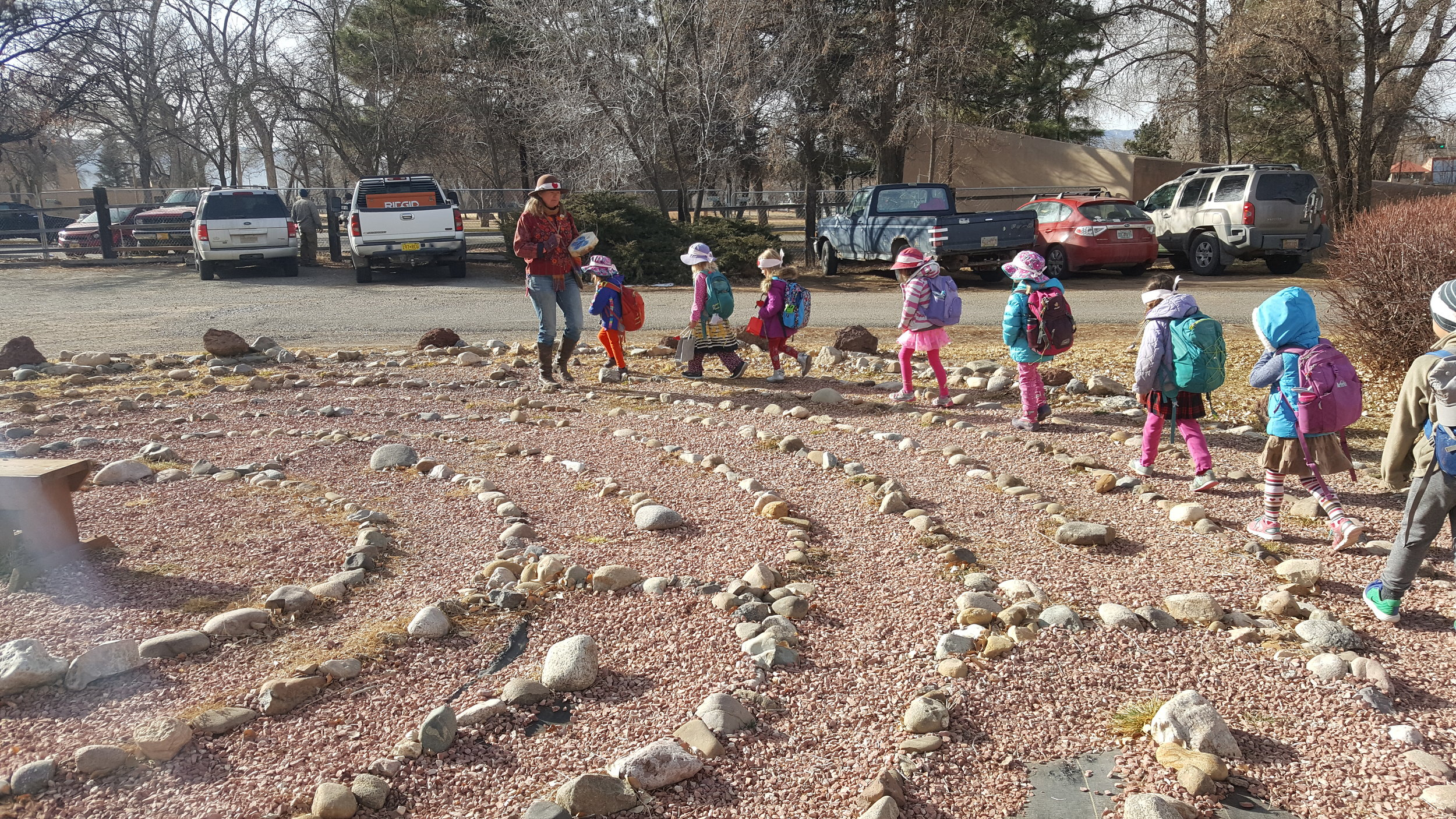 Walking the labyrinth outside the Presbyterian church. We encountered an AA group or something of the sort just prior - the kids sang and handed out felt hearts and cookies. So sweet.