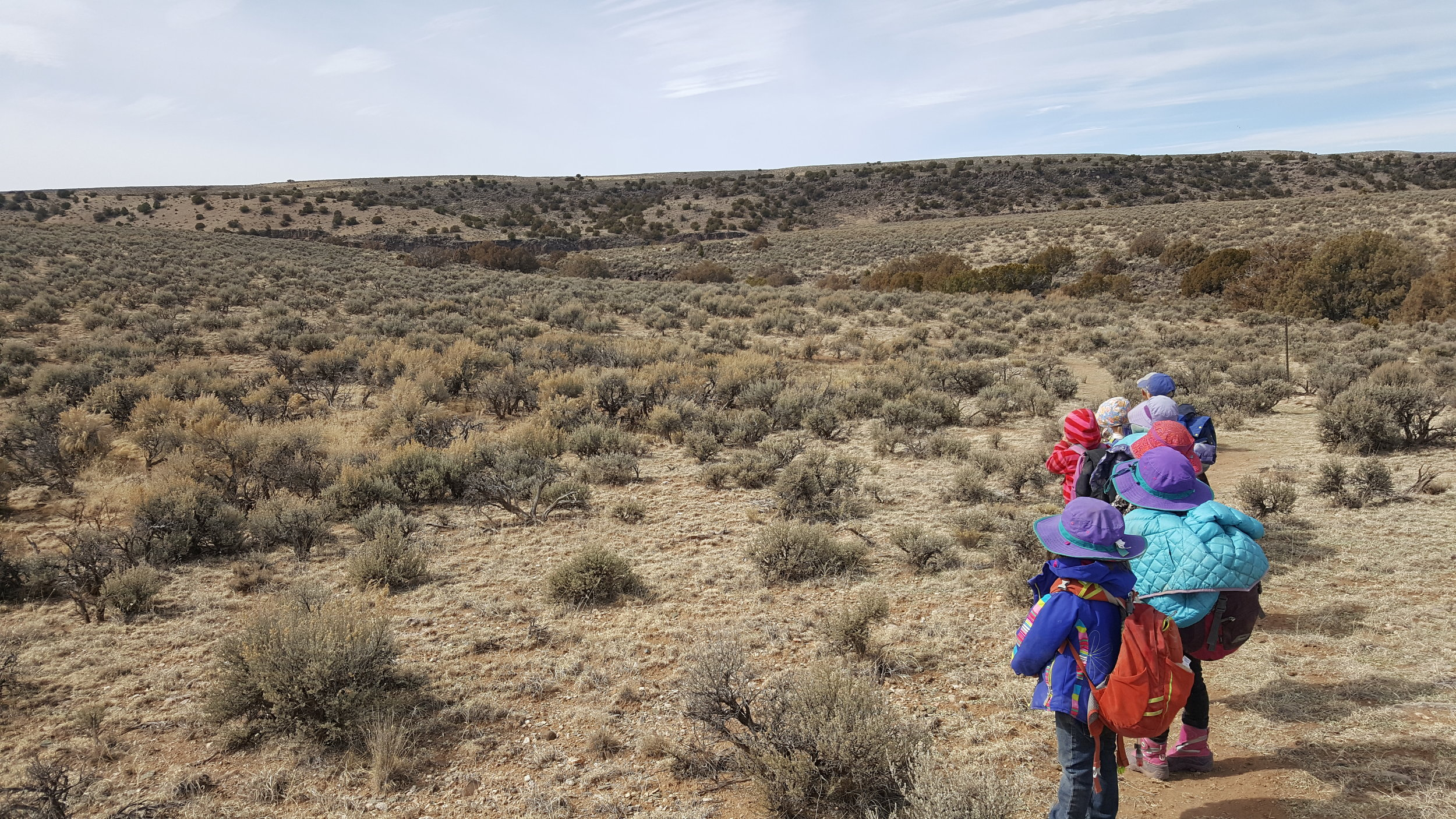 The kids staring at two big horn sheep. They were clear as day in real life, but the photo makes them so small you don't even see them. Oh well.