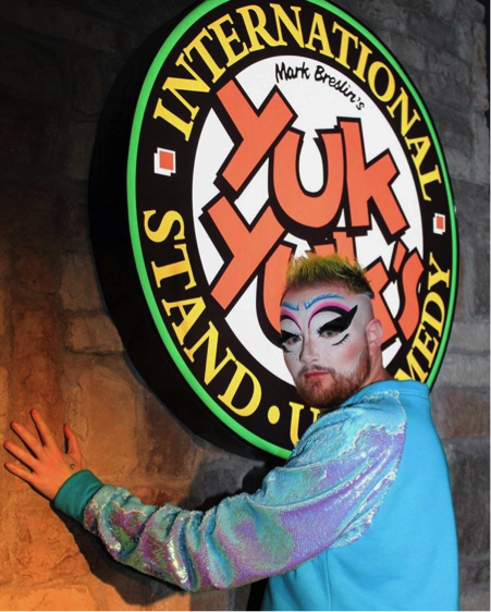 Dust in front of the Yuk Yuk's sign to advertise the Yuk it Up Sis: A comedy Drag Show performance