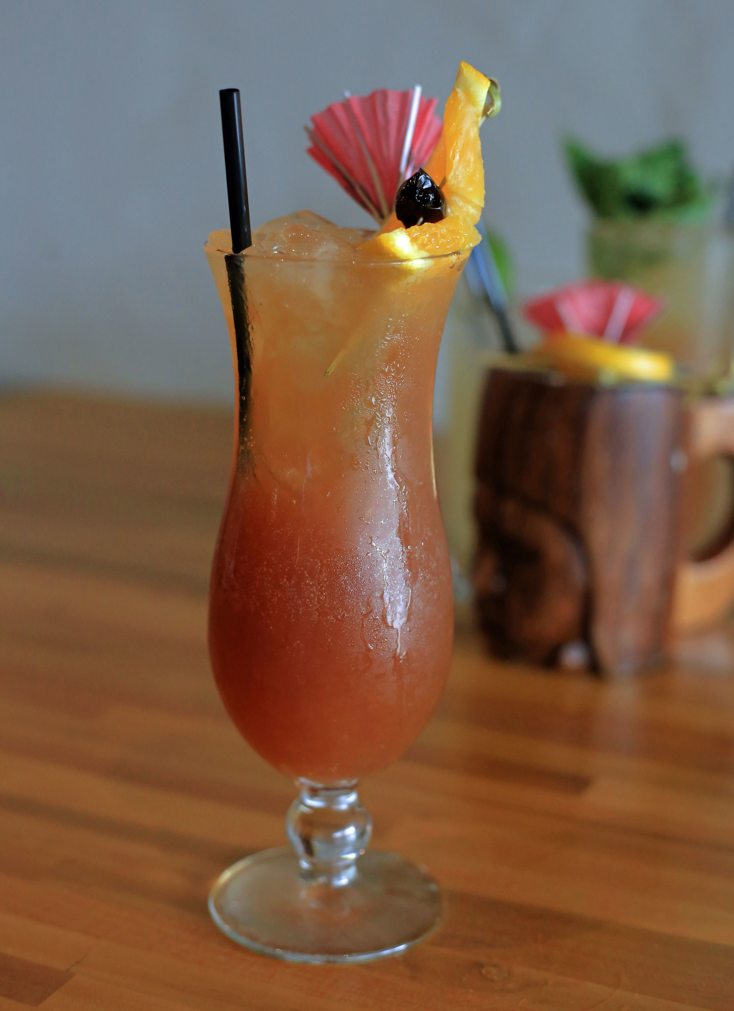 Hurricane - Passion fruit, simple syrup, grenadine, lemon juice, dark Jamacian rum. Easily gone too quickly and a drink that will catch up with you fast.