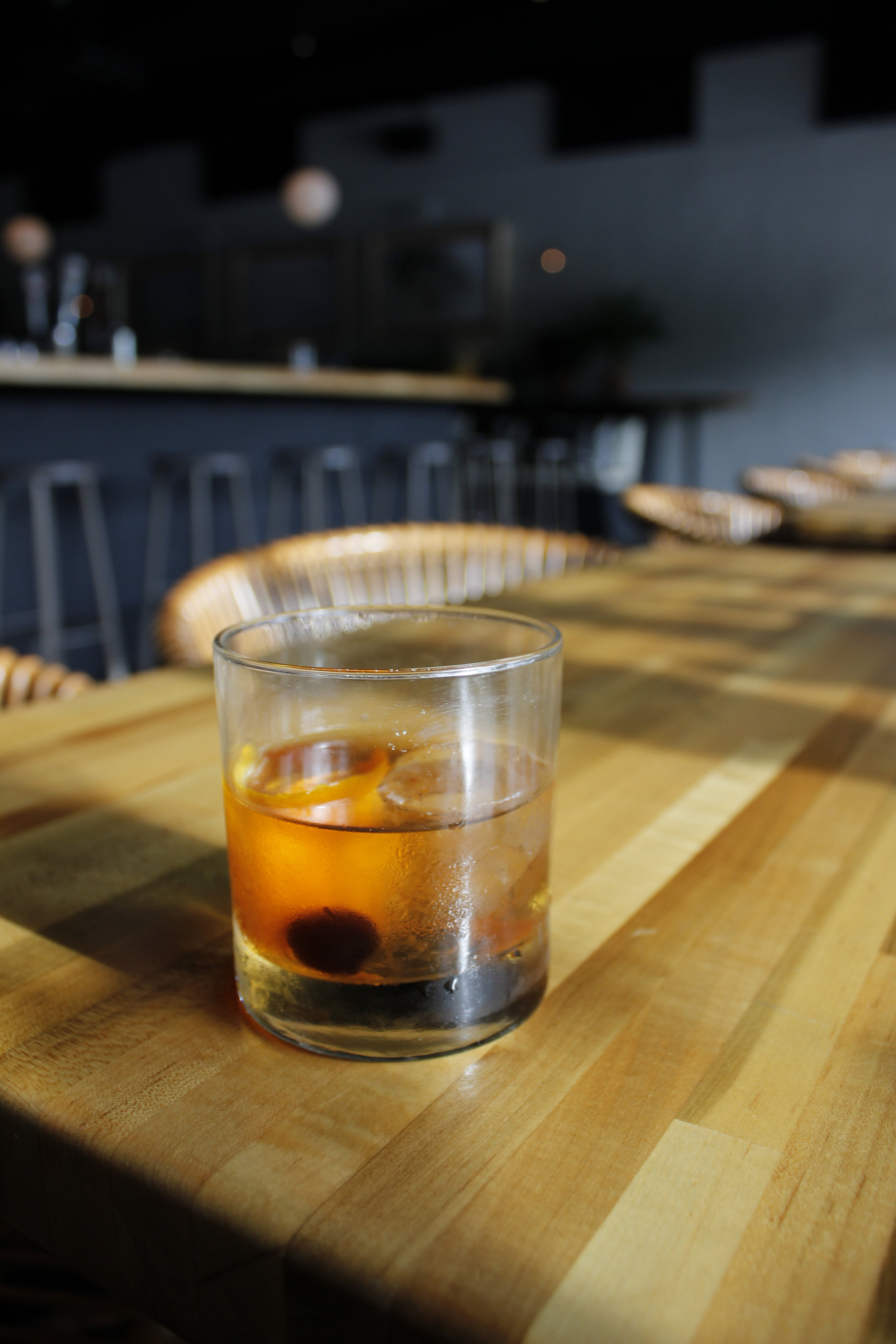Old Fashioned - Four Roses Bourbon, Angostura, sugar, orange, and cherry. A classic you can't go wrong with, and a great way to introduce yourself to bourbon.