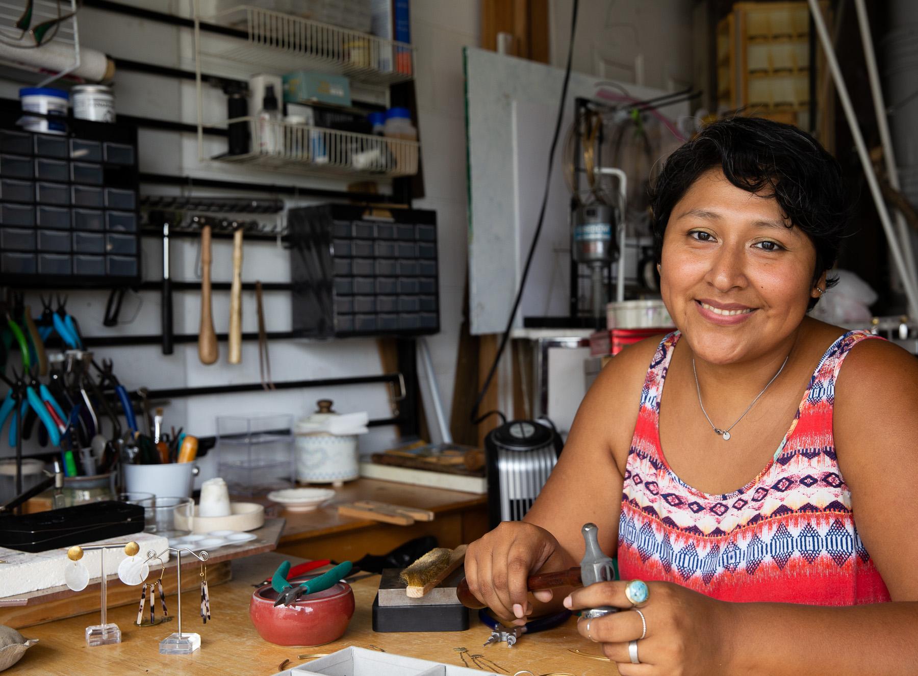 Orlando jewelry designer Carla Poma creating in her studio.