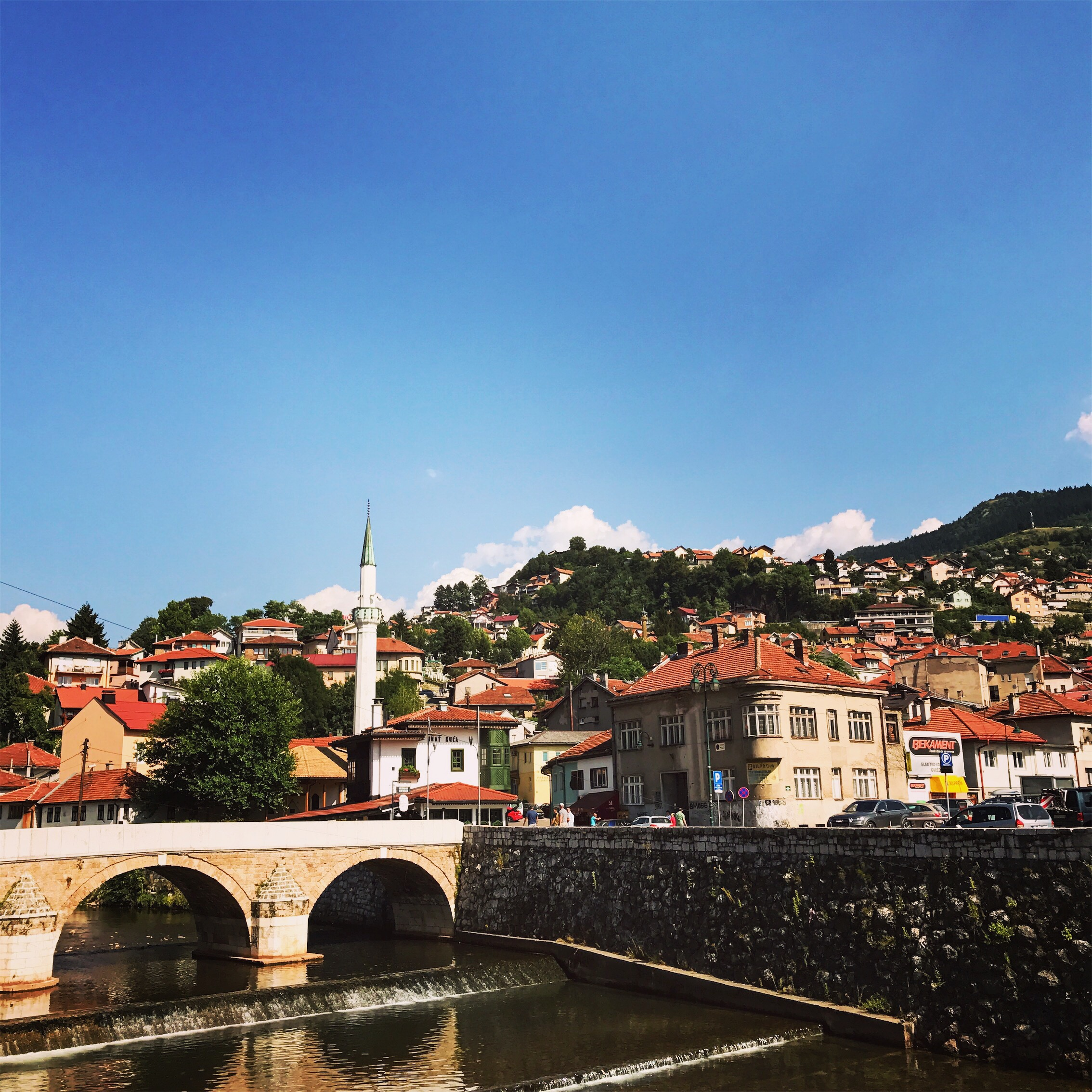 Picturesque Sarajevo. Behind me (not pictured) is the Latin Bridge, built by the Ottomans in the 1500s. More significantly, it's next to where Bosnian-Serb Gavrilo Princip, who was part of a group plotting to end  Austro-Hungarian  rule, assassinated heir Archduke Franz Ferdinand, igniting World War I.