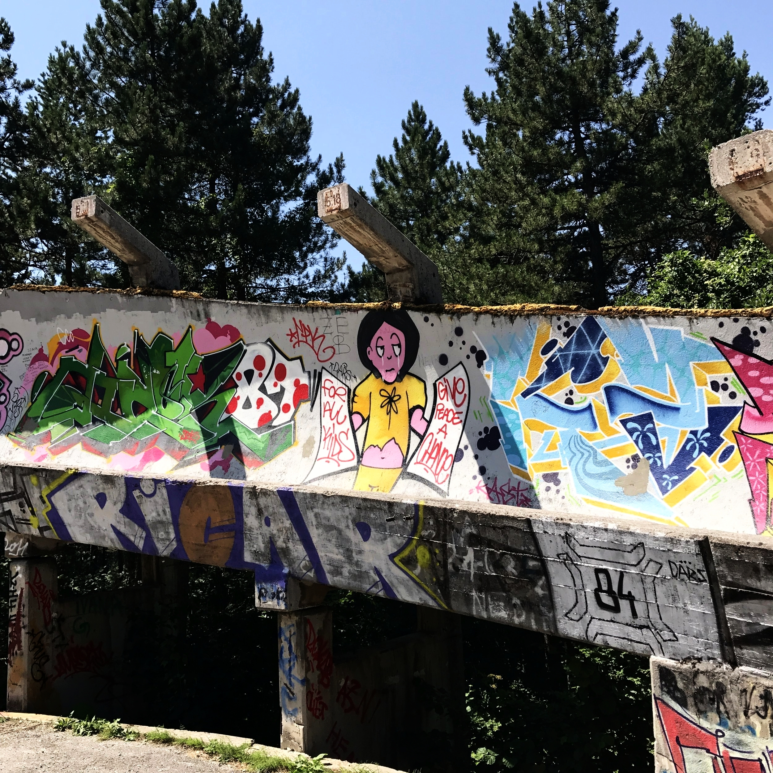 Graffiti remains of the bobsled track from the 1984 Winter Olympics.People stole metal out of here for scrap, and it sort of fell into disrepair until 2014, when it was cleaned up.