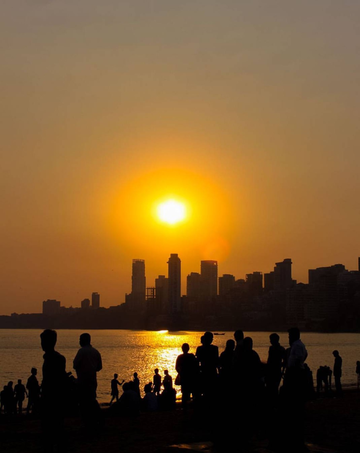 """One of the quintessential Mumbai experiences is to visit Chowpatty Beach at sunset. You can people watch, as all 18 million residents seem to stop by for the view, and also indulge in some of the best street food in the city."""