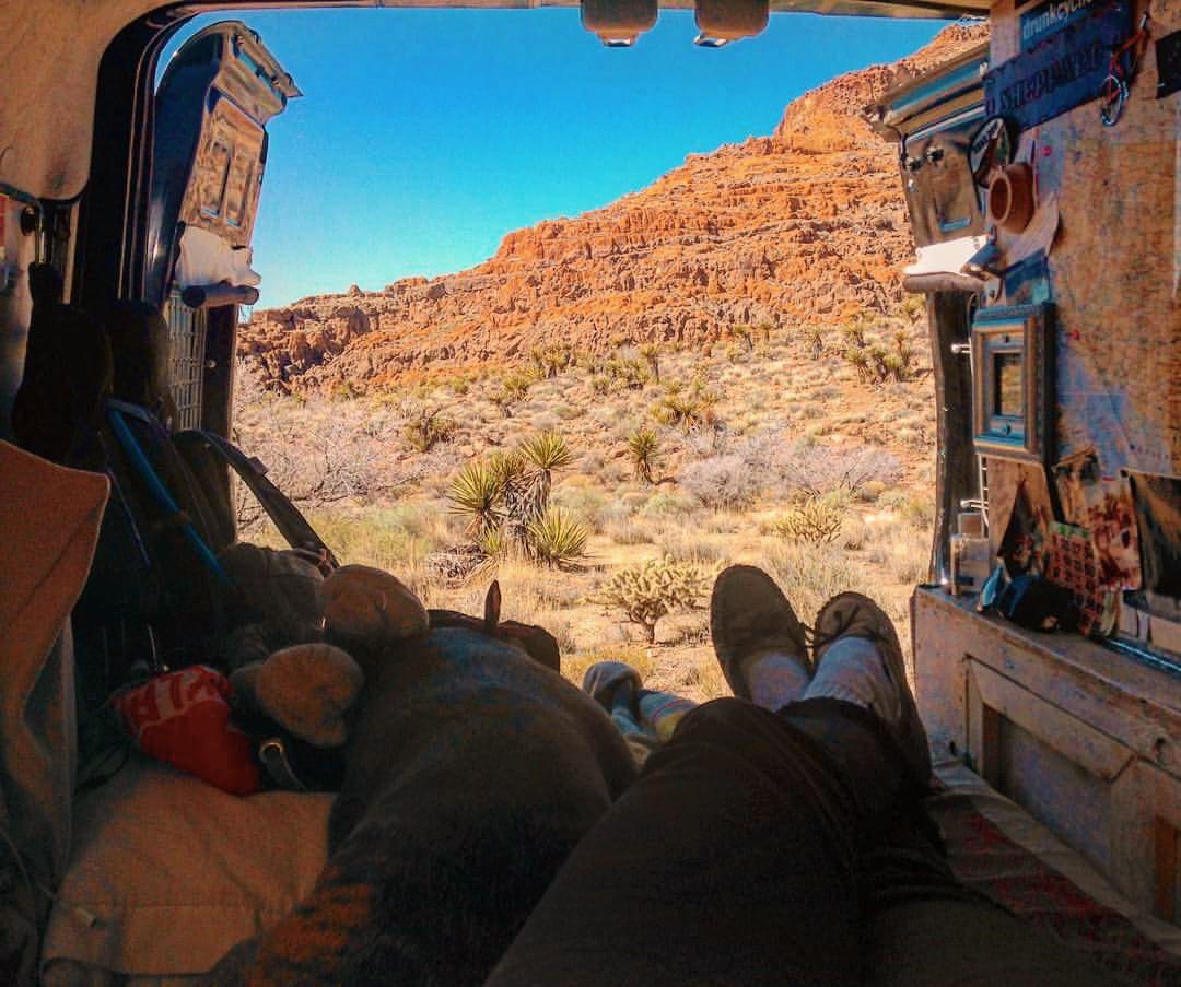Casey kicking back inside her van and enjoying van views.