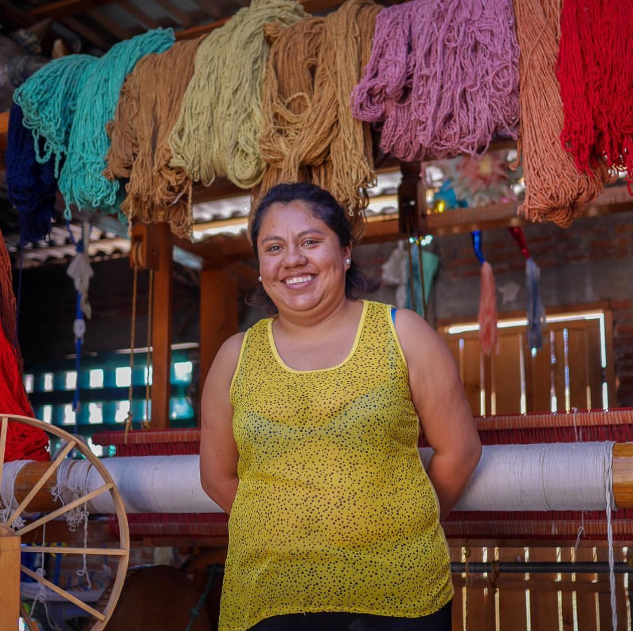 A participant in the microfinance organization Fundación En Vía. The nonprofit doesn't rely on donations. Rather, they run tours out into communities of indigenous women who use micro-loans to build their businesses. Visitors can tour their workshops to learn about their culture and skills, and the fee for the tour gets reinvested back into the loan pool that these women can pull from again.  Photo by Shannon O'Donnell .
