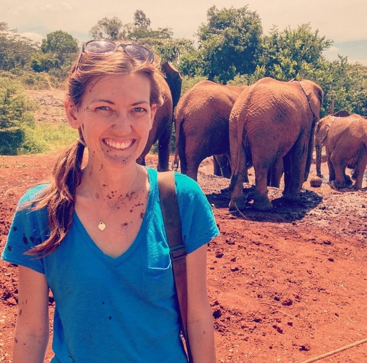 """David Sheldrick Wildlife Orphan Trust. """"They tell me getting sprayed from head to toe with mud by the orphaned baby elephants is a blessing,"""" Shannon says. """"I think they were just trying to make me feel better!""""  Photo by Shannon O'Donnell ."""